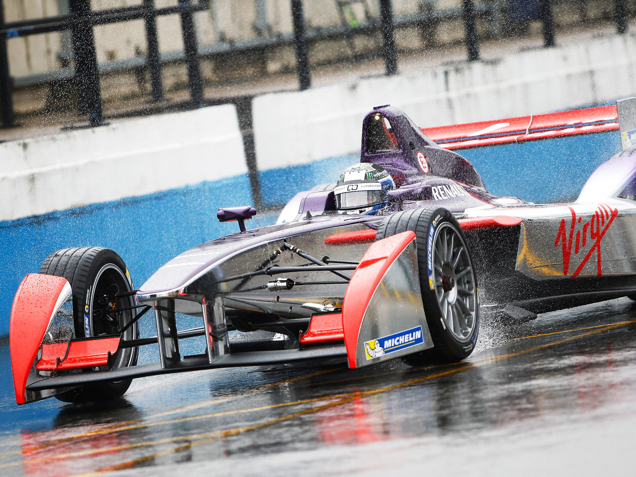 Donington, UK: A Formula E car on a wet track. This image is from Formula E: Racing Recharged. [Photo of the day - September 2014]