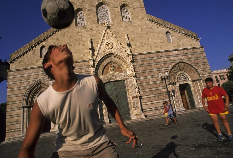 Soccer in front of the 12th century Cathedral in Messina, Sicily. [Photo of the day - April 2011]