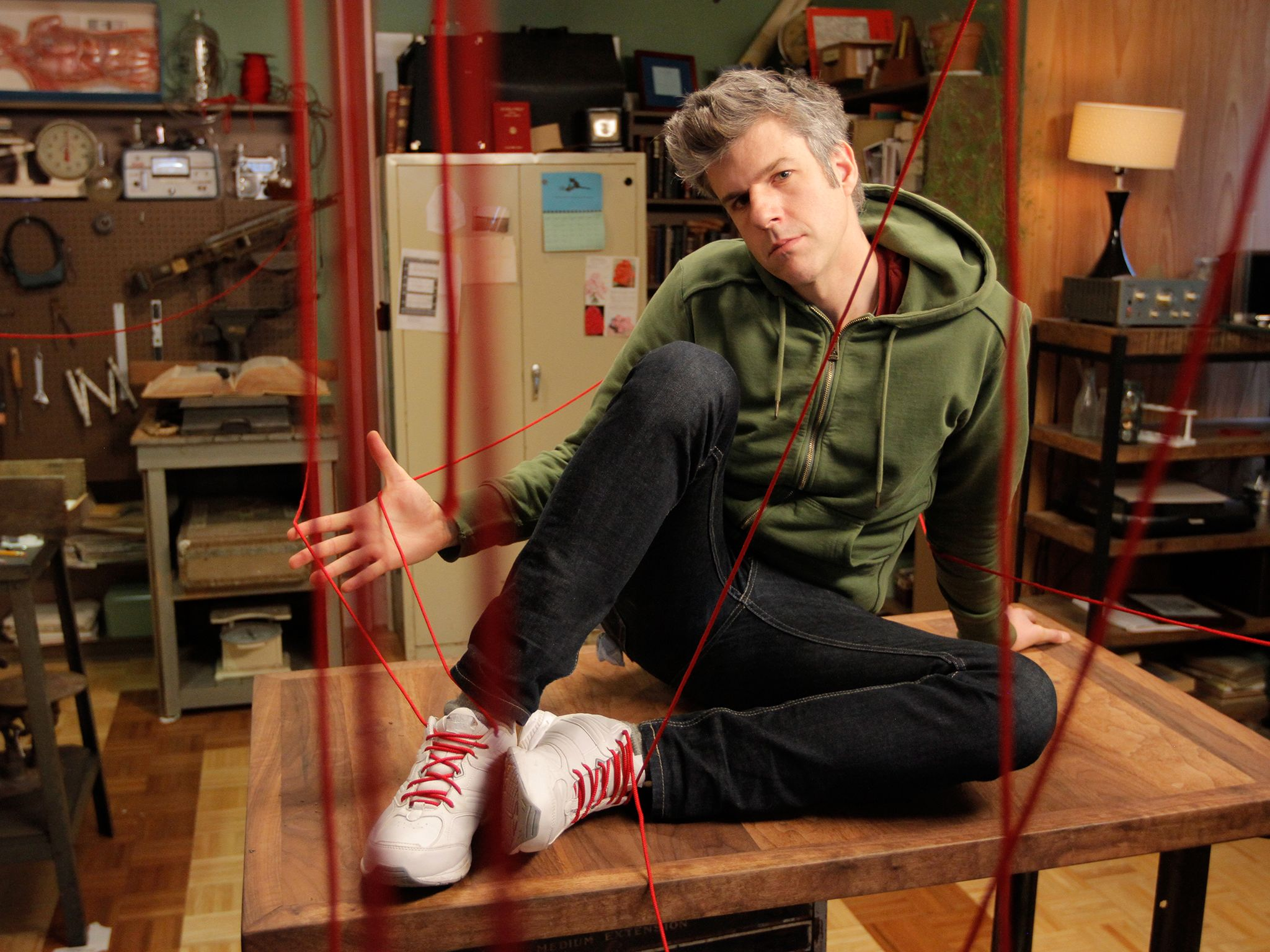 Beacon, NY: David Rees poses on top of his workbench with 50-foot laces strewn about his... [Photo of the day - October 2014]