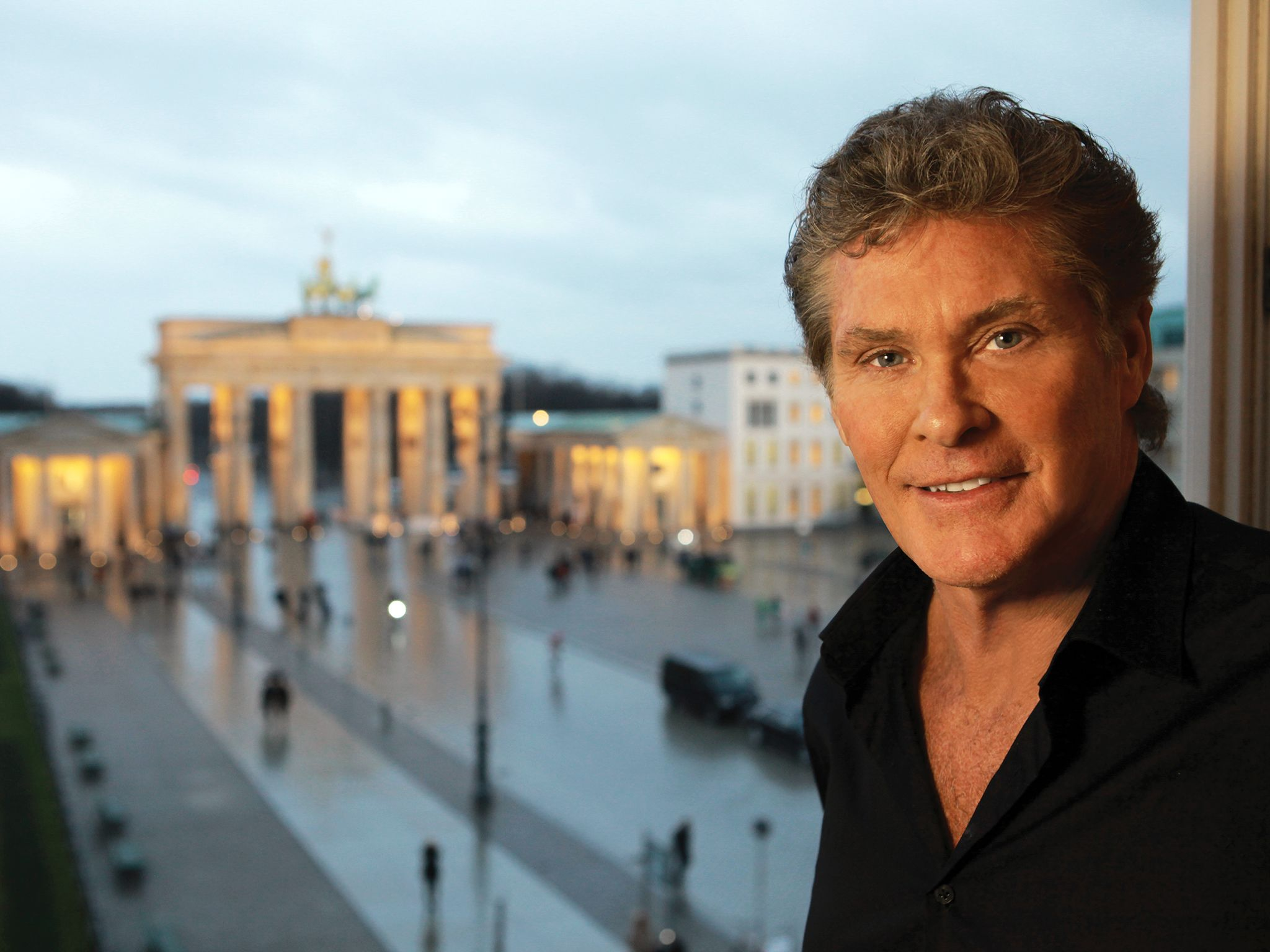 Berlin, Germany: David Hasselhoff in his hotel room overlooking the Brandenburg Gate. This image... [Photo of the day - November 2014]