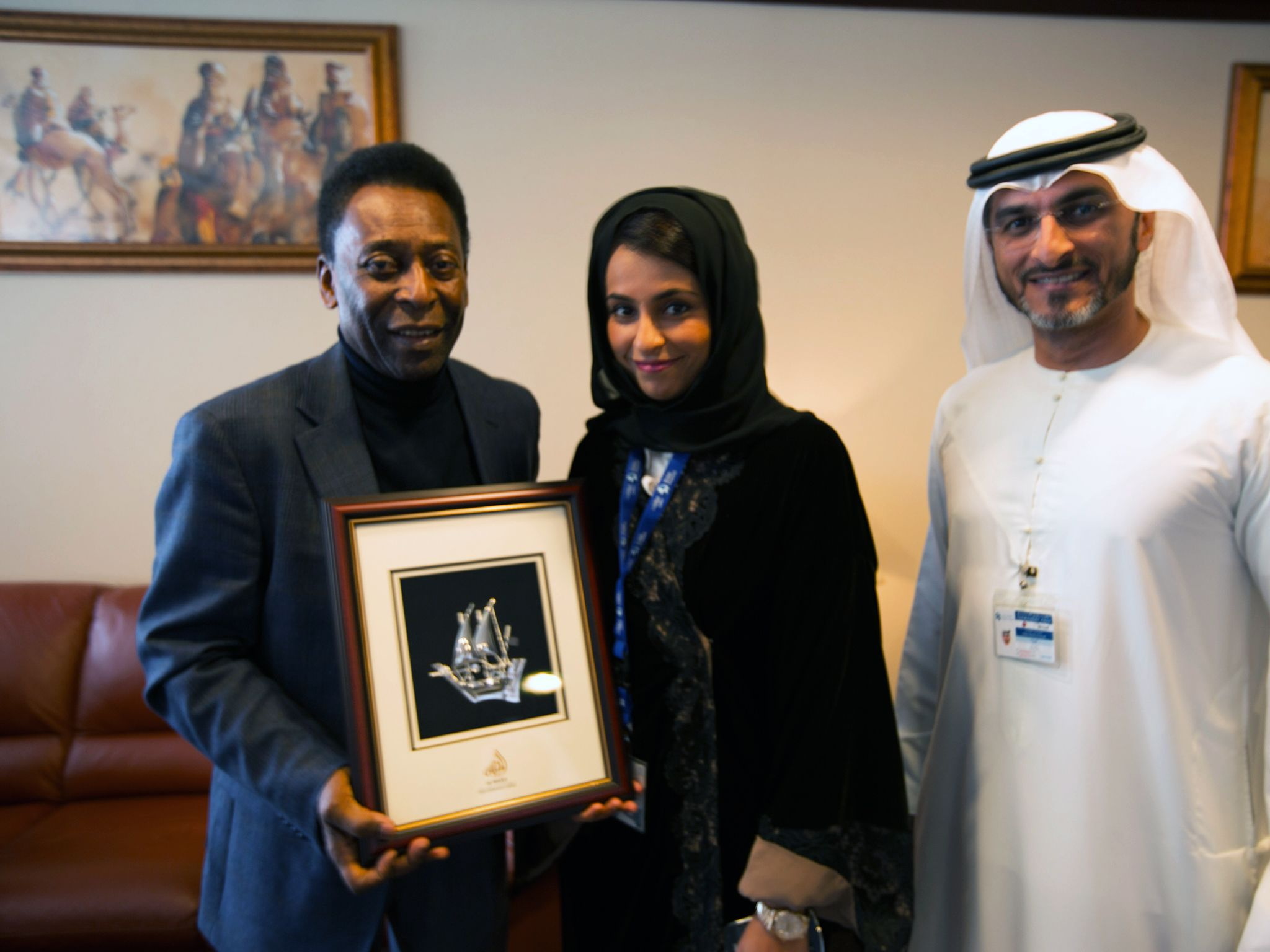 Dubai Airport, UAE: Pele poses for photos with Najla Al Midfa and Rabee Al Awadi. This image is... [Photo of the day - December 2014]
