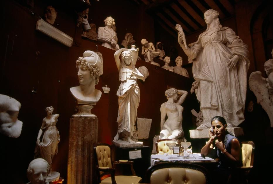 A woman talking on a cellphone in Canova Tadolini Restaurant, Rome. [Photo of the day - April 2011]