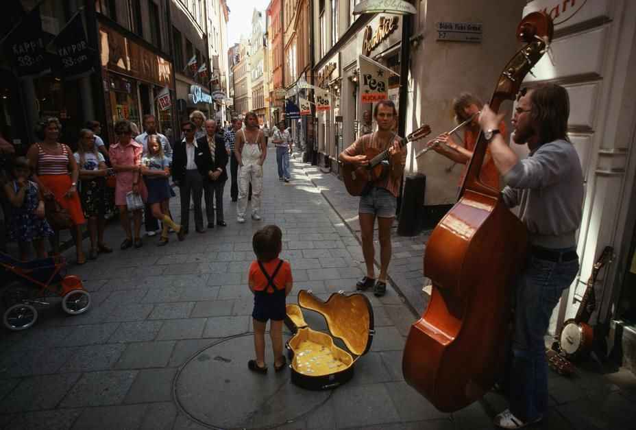 Pedestrians stop to listen to street musicians in Stockholm.  [Photo of the day - April 2011]