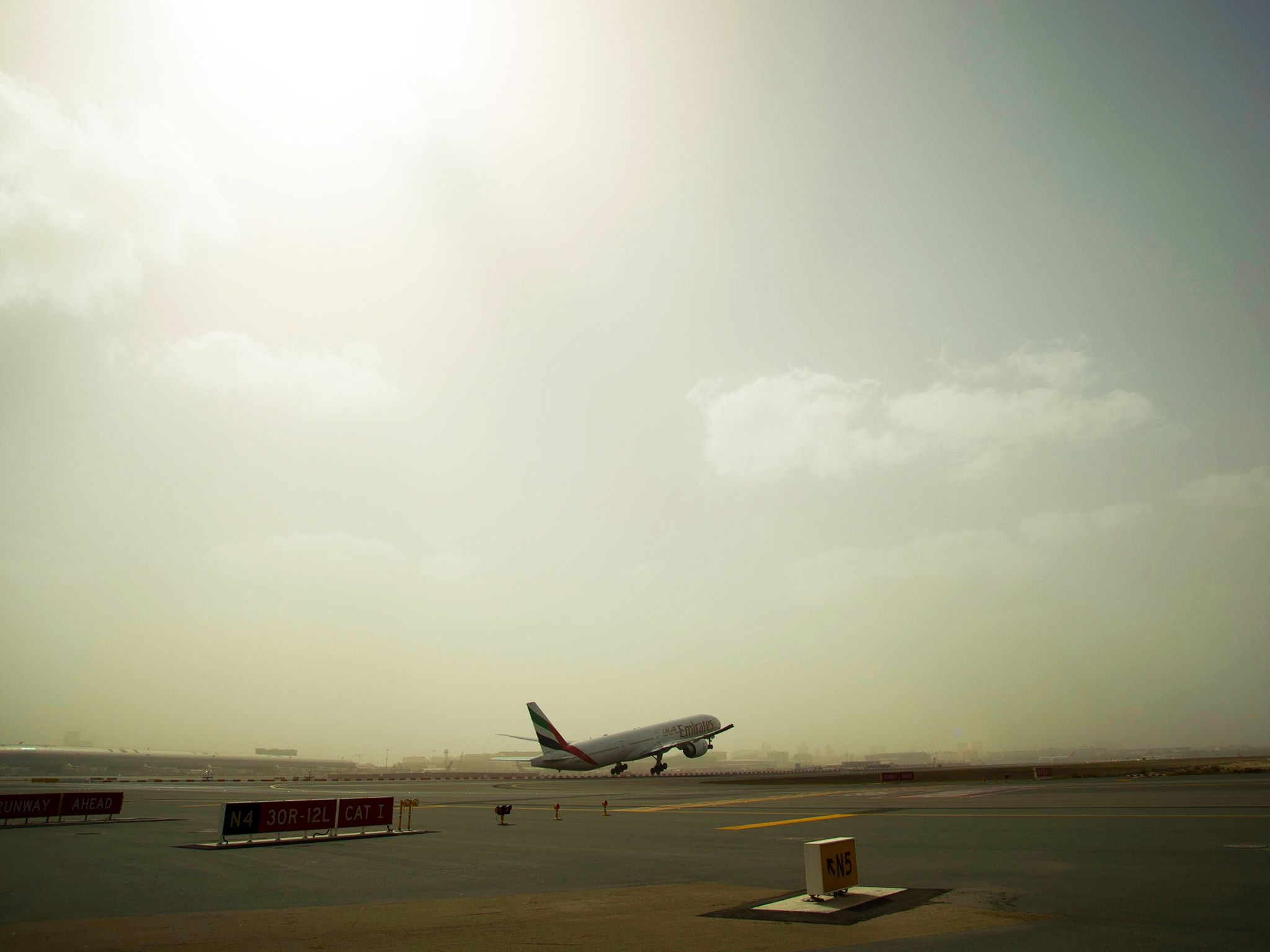 Dubai Airport, UAE: A picturesque shot of a plane taking off. This image is from Urban Jungle... [Photo of the day - December 2014]