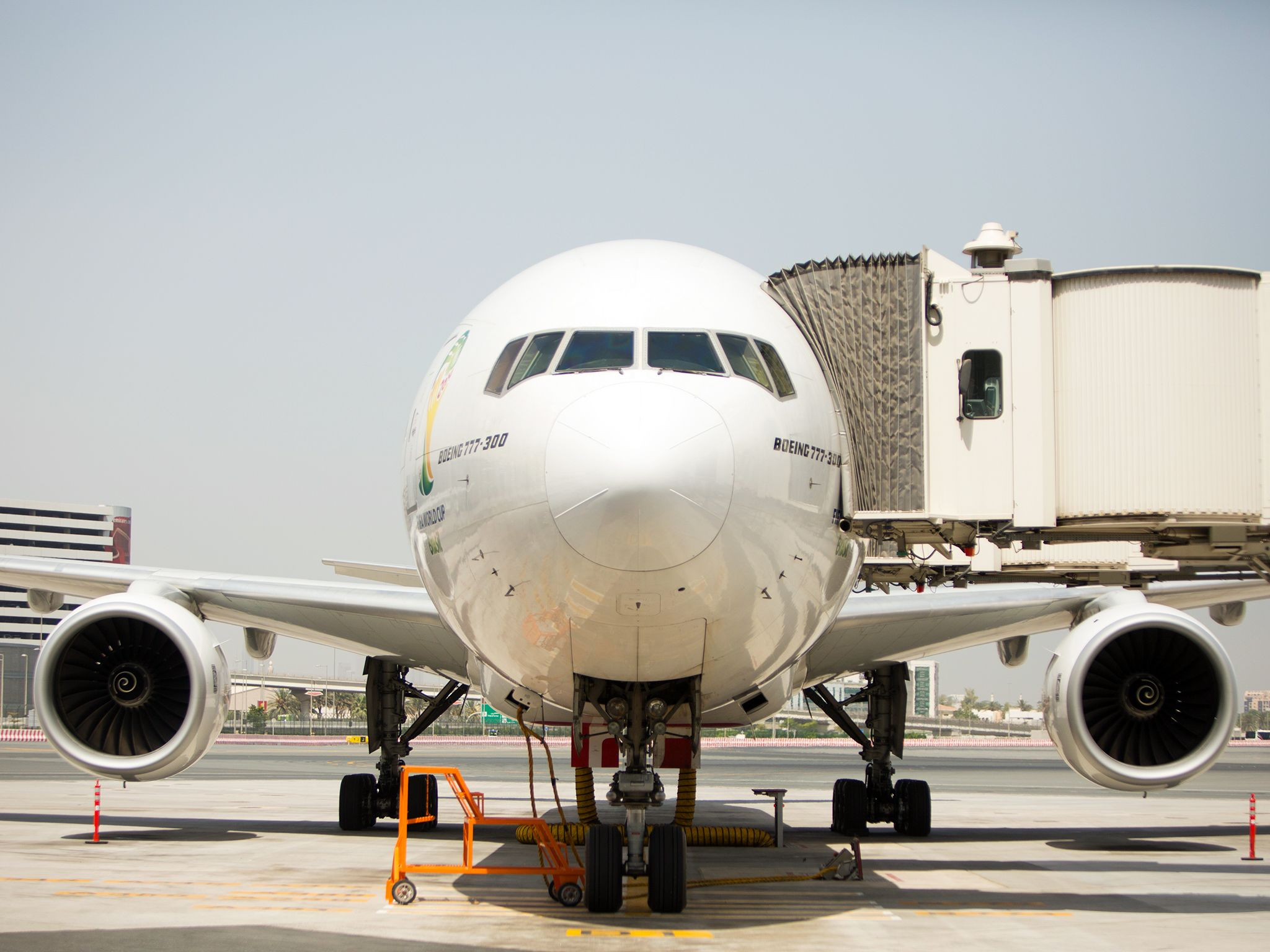 Dubai Airport, UAE: Shot of a Boeing 777-300, parked at stand, front view, aerobridge attached.... [Photo of the day - December 2014]