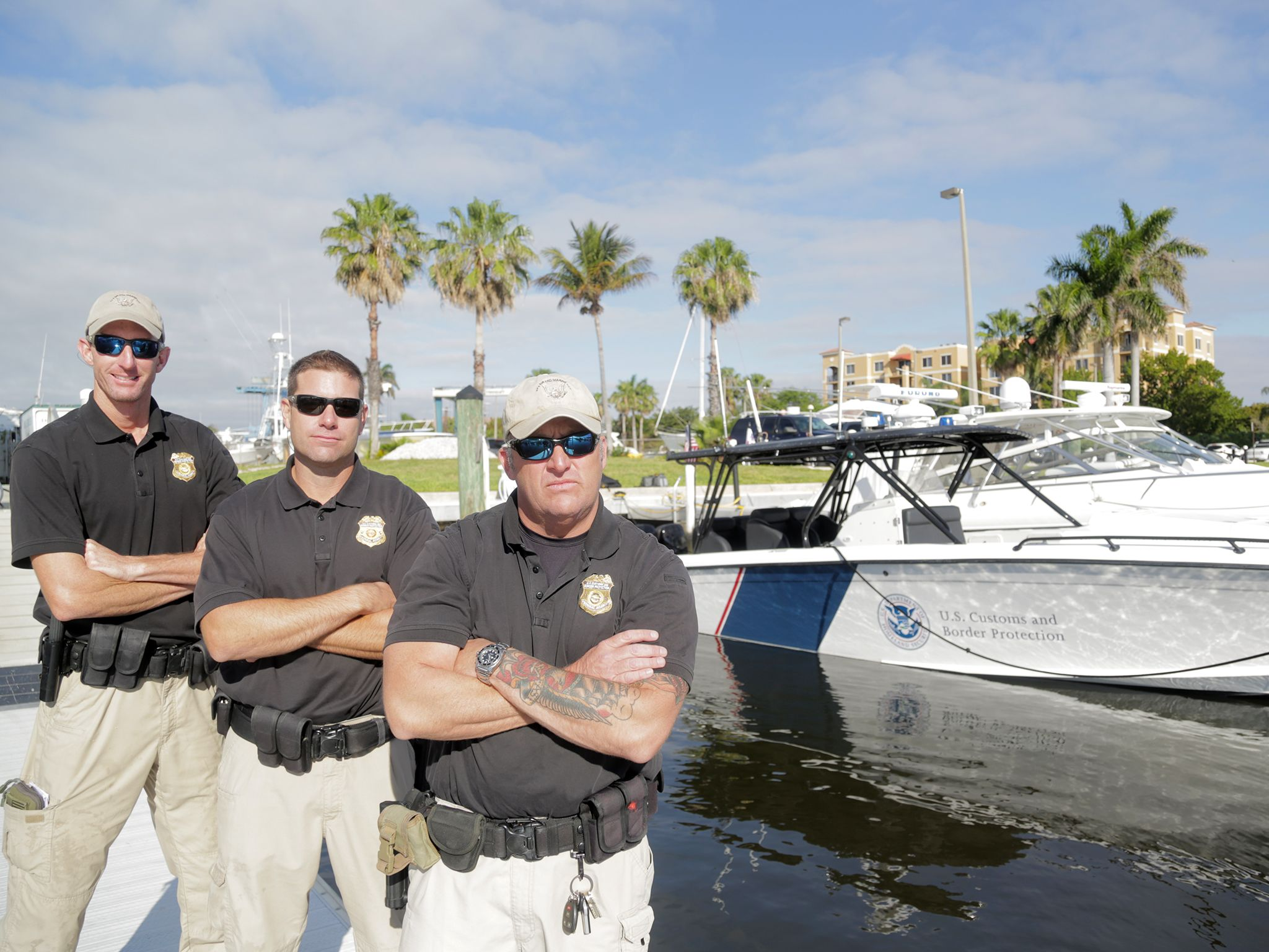 West Palm Beach, Fla.: Jack Creaig Custom Border Protection Commander and crew by their boat in... [Photo of the day - January 2015]