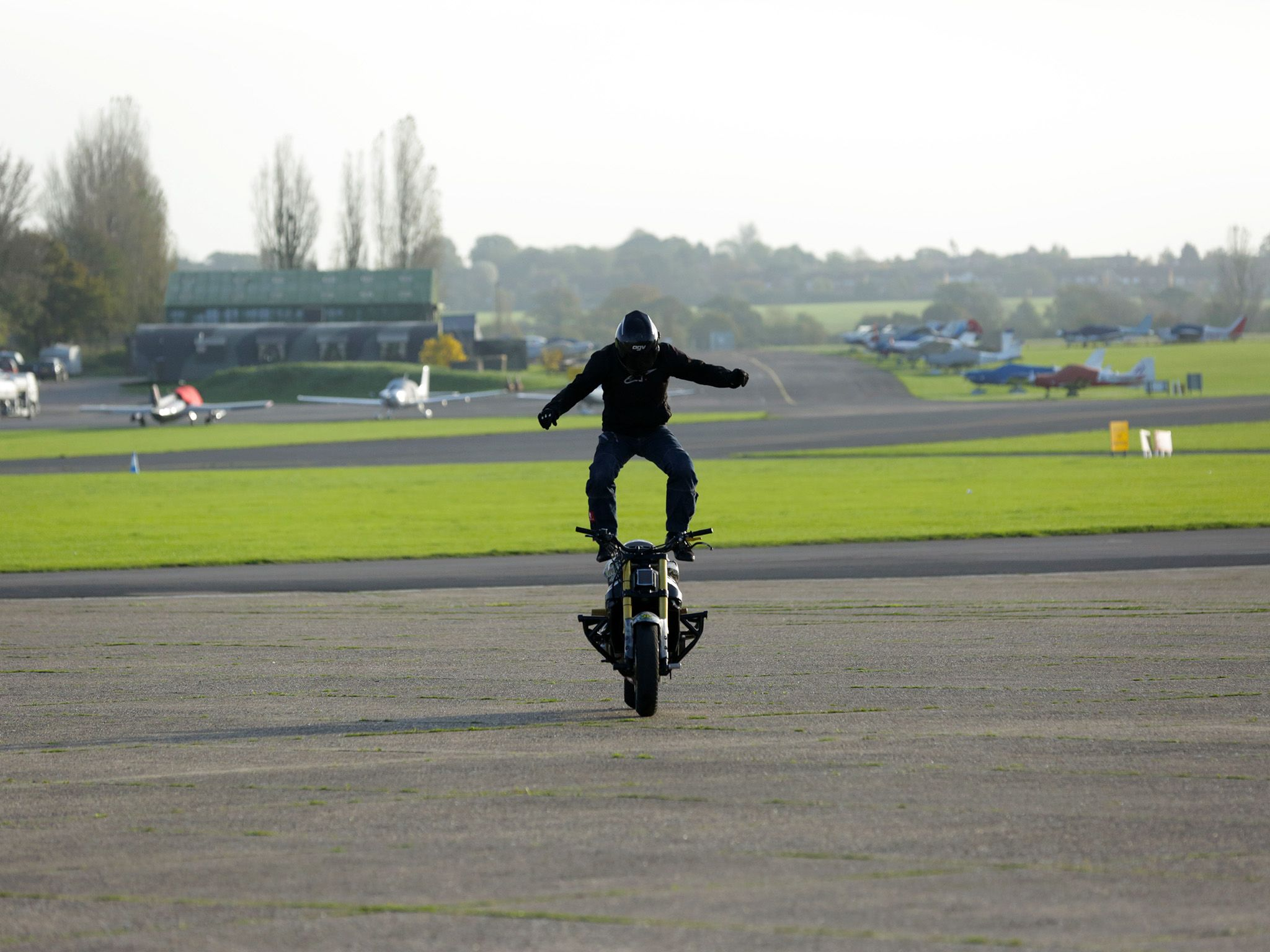 Essex, England: Mark Van Driel performing the stunt Moto Surfing where a rider stands on a... [Photo of the day - February 2015]