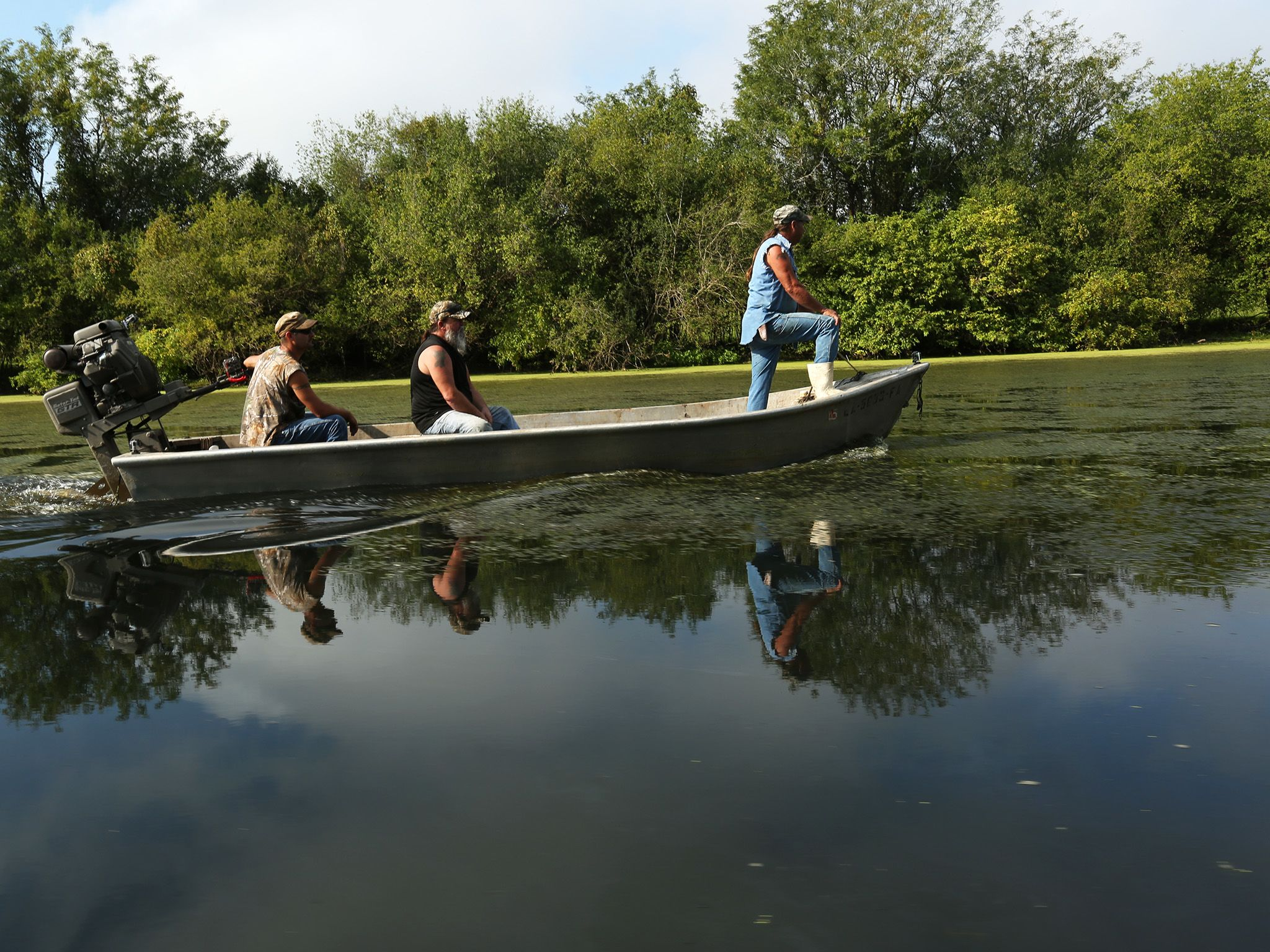 Morganza, LA.: Seth, David, and Keith in their boat as they continue to set traps in hopes of... [Photo of the day - May 2015]