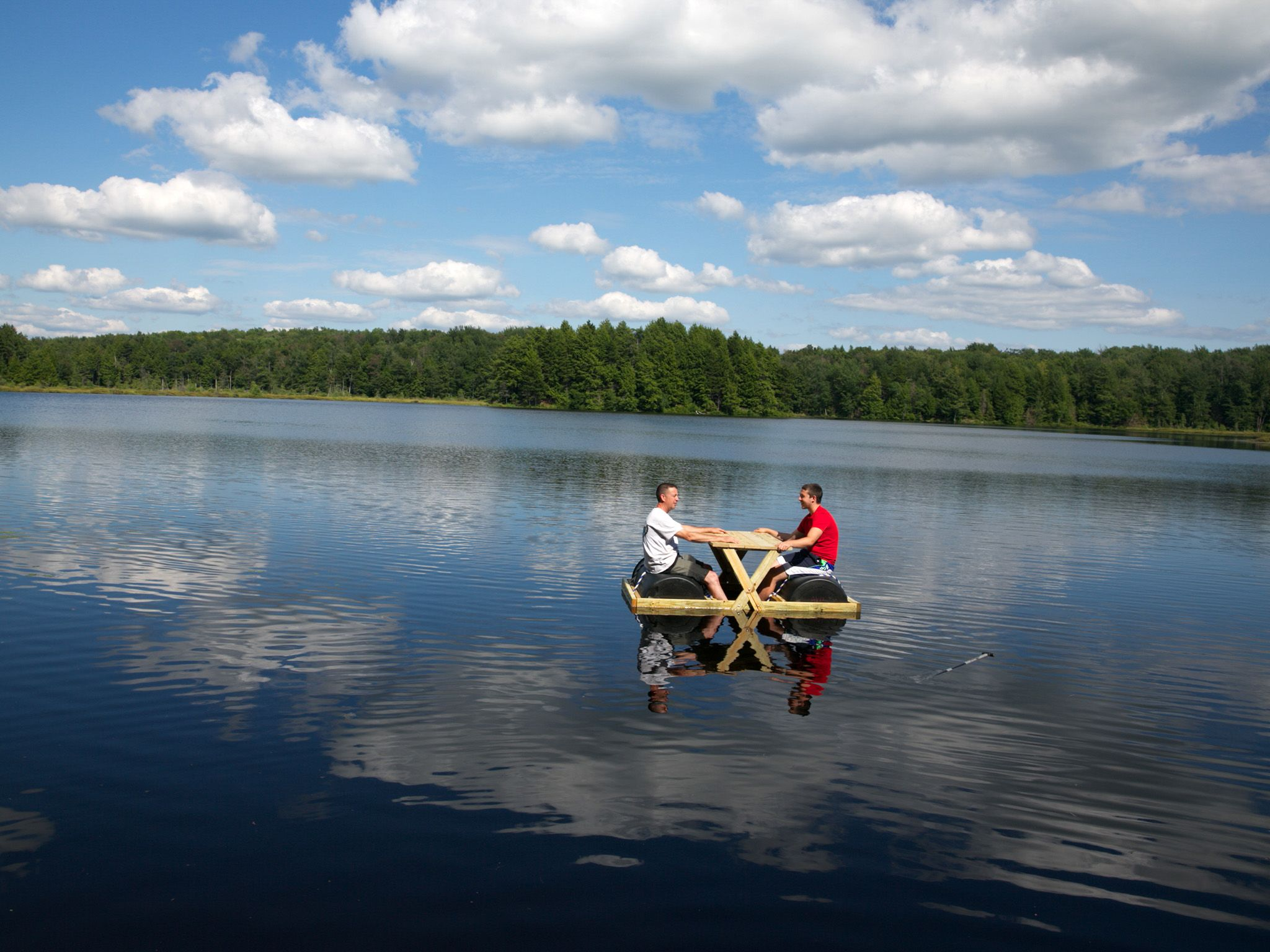 Bennington, VT: Tom Kiely and his son sit on a floating park bench on the lake. This image is... [Photo of the day - May 2015]