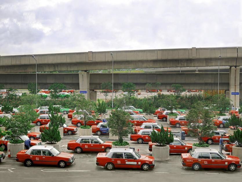 A sea of taxis parked outside of the Hong Kong airport waiting for passengers. [Photo of the day - می 2011]