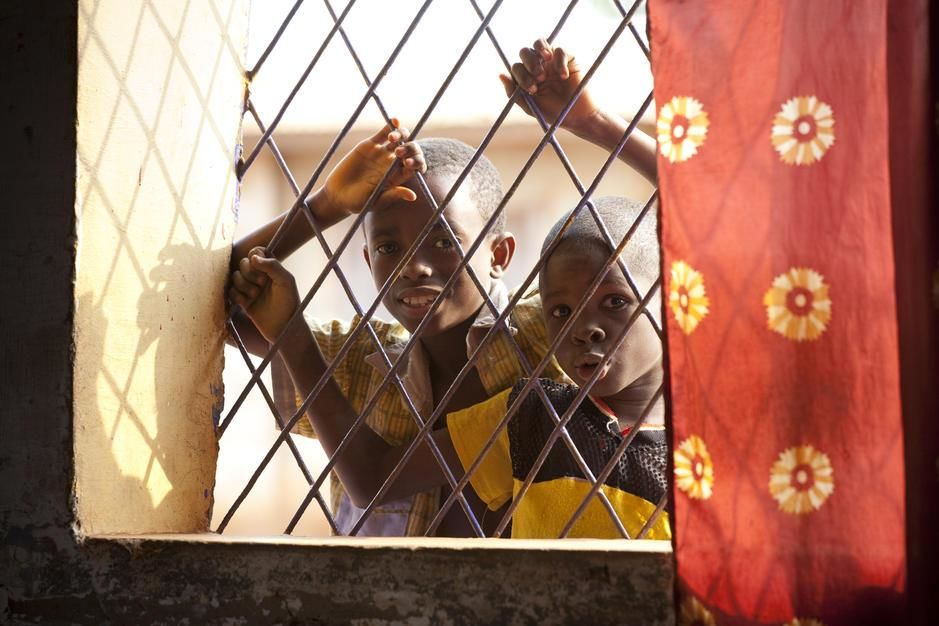 Two young boys peer through a bar window. [Photo of the day - می 2011]