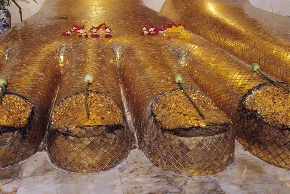 The gilded feet of a colossal standing Buddha at Wat Intrawiharn Temple in Bangkok. [Photo of the day - June 2011]
