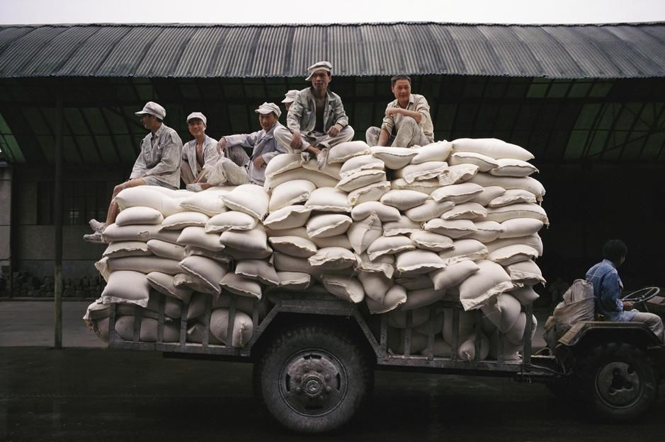 Men sit on bags of flour at a manufacturing plant in Hunan Province. [Photo of the day - June 2011]