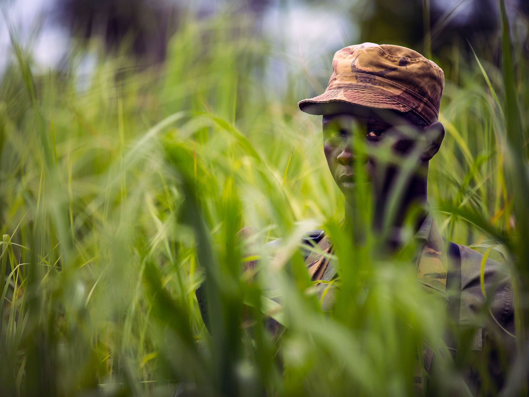 Garamba National Park, Democratic Republic Of Congo: A Garamba ranger looks through tall grass... [Photo of the day - September 2015]