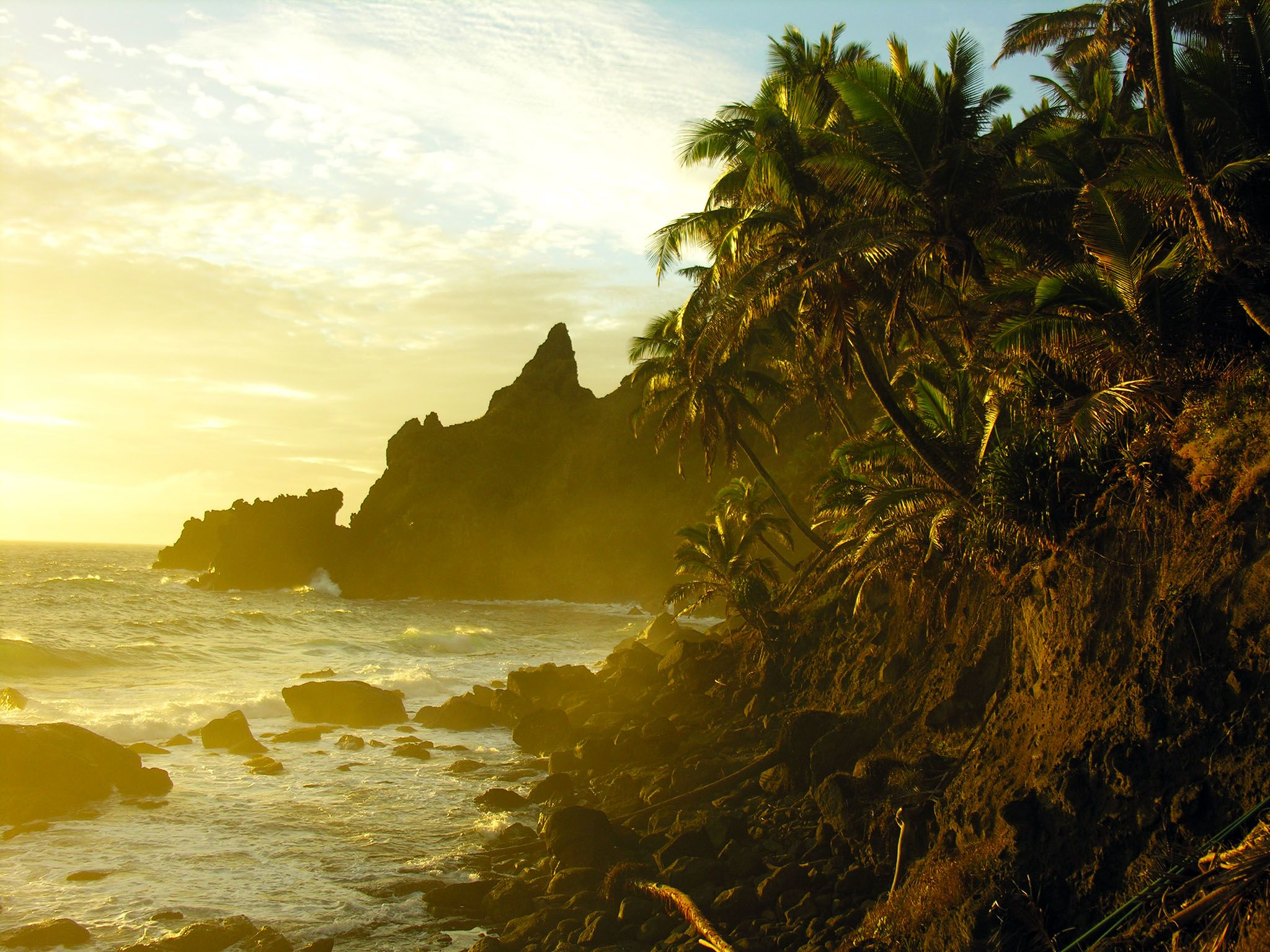 Pitcairn Island, Pitcairn Islands: The sunrise blazes over the cliffs and tropical trees of... [Photo of the day - October 2015]