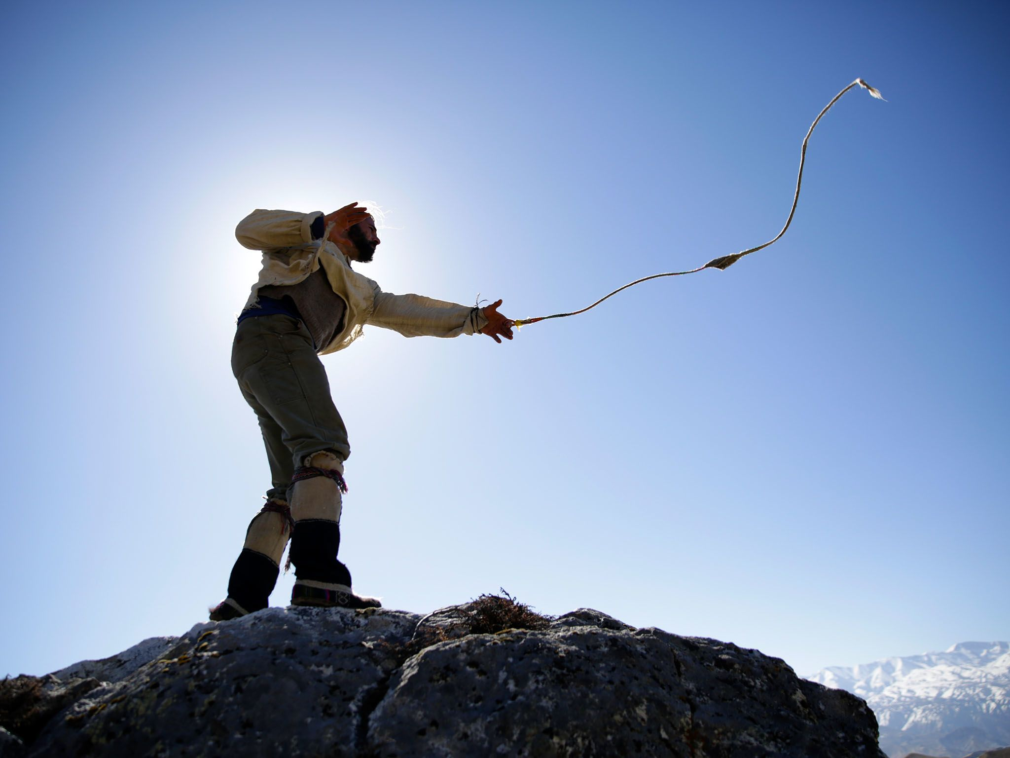 Mustang, Nepal: Hazen practicing slingshot with the sun behind him. This image is from Primal... [Photo of the day - January 2016]