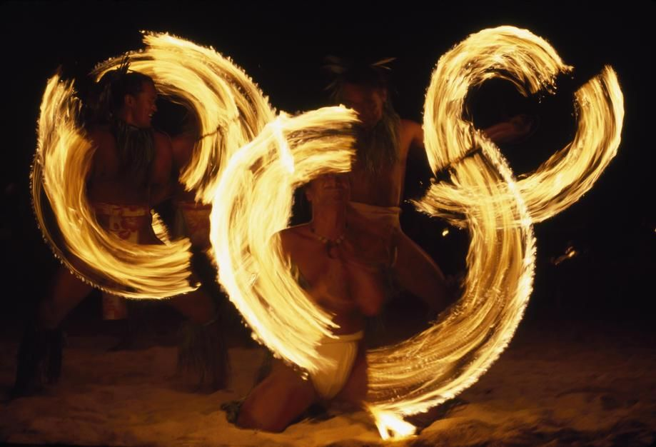 Torch-twirling Tahitians stage a dance at a beachfront resort on Tahiti Island. Polynesia. [Photo of the day - August 2011]