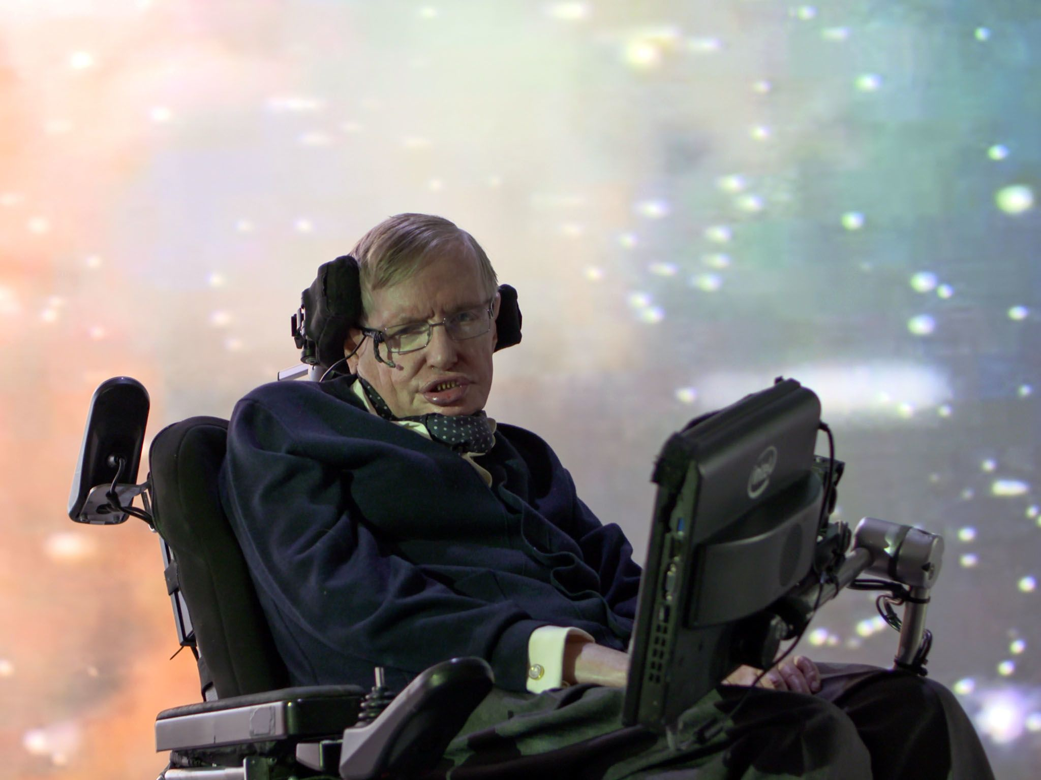 Cambridge:  Stephen Hawking in front of a galaxy projection. This image is from Genius by... [Photo of the day - May 2016]