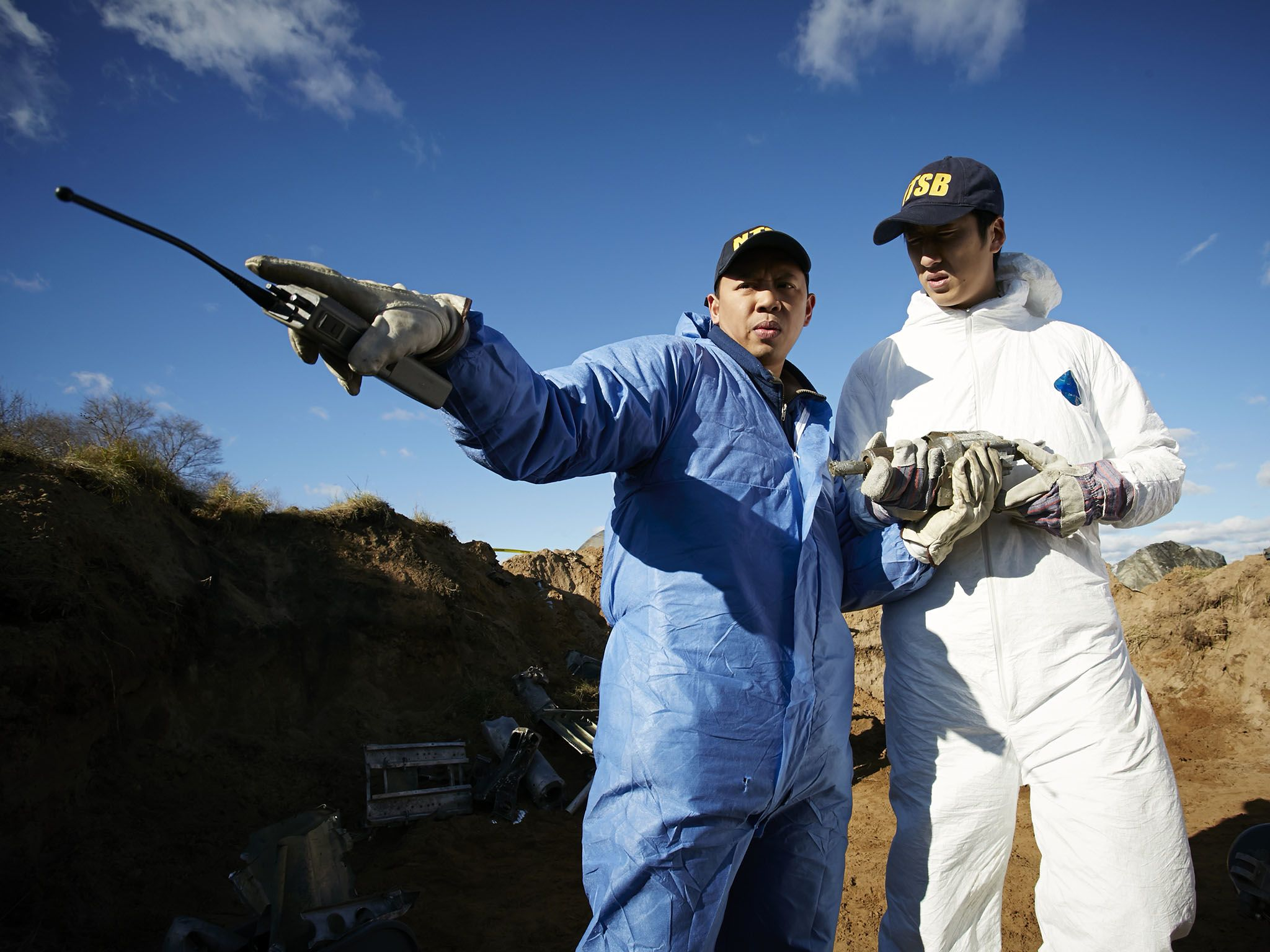 Reenactment: NTSB Investigator (played by Byron Abalos) and another investigator stand in the... [Photo of the day - May 2016]