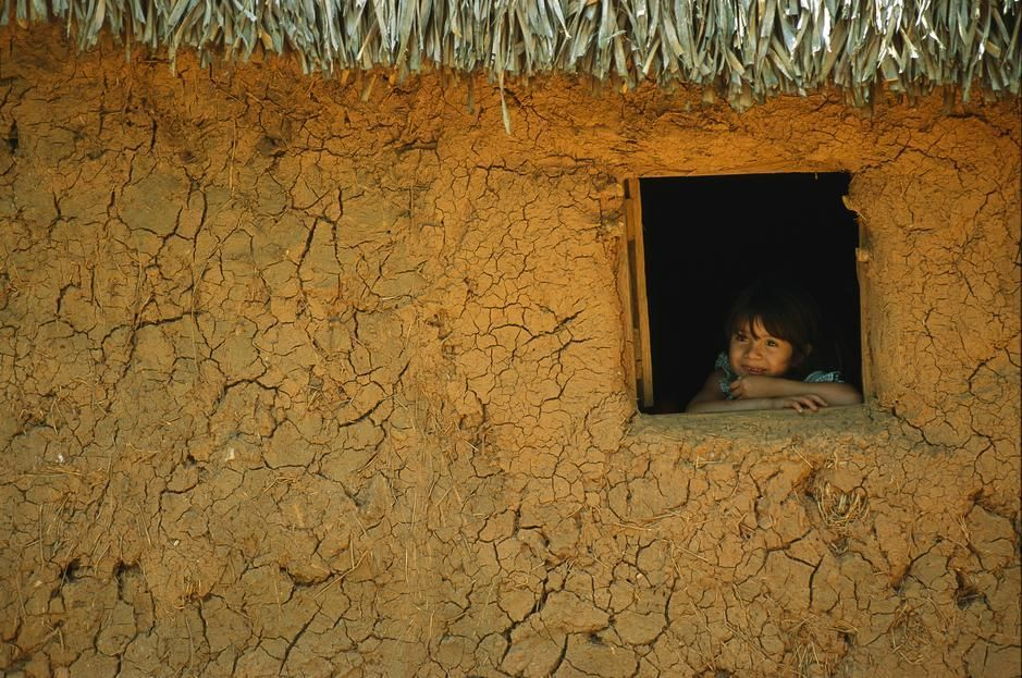 A young girl looks dreamily out of a window in Veracruz State. [Photo of the day - July 2011]