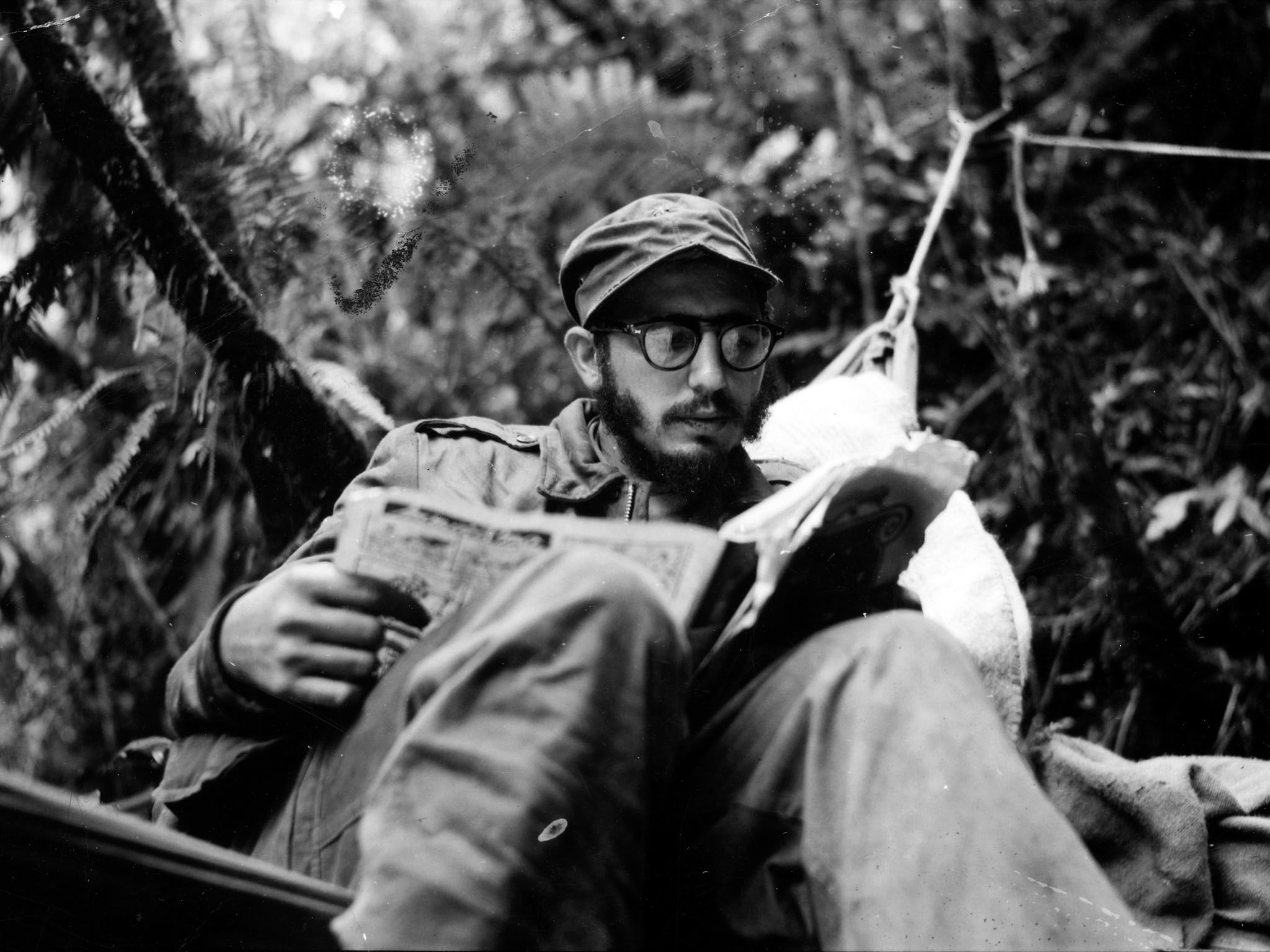 Sierra Maestra Mountains, Eastern Cuba: Fidel Castro catches up on the news at an outpost in the... [Photo of the day - June 2016]