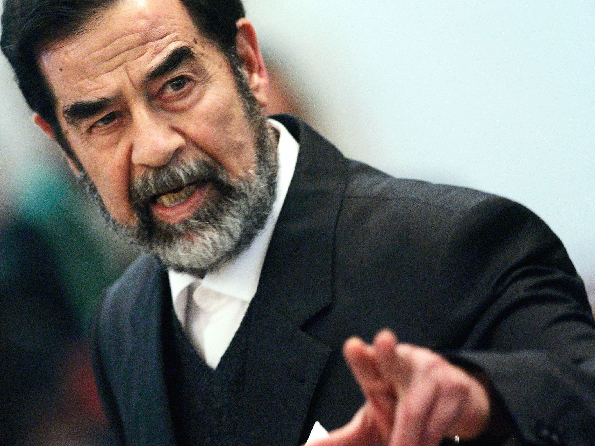 Baghdad, Iraq: Former Iraqi President Saddam Hussein addresses the court of the Iraqi High... [Photo of the day - October 2016]