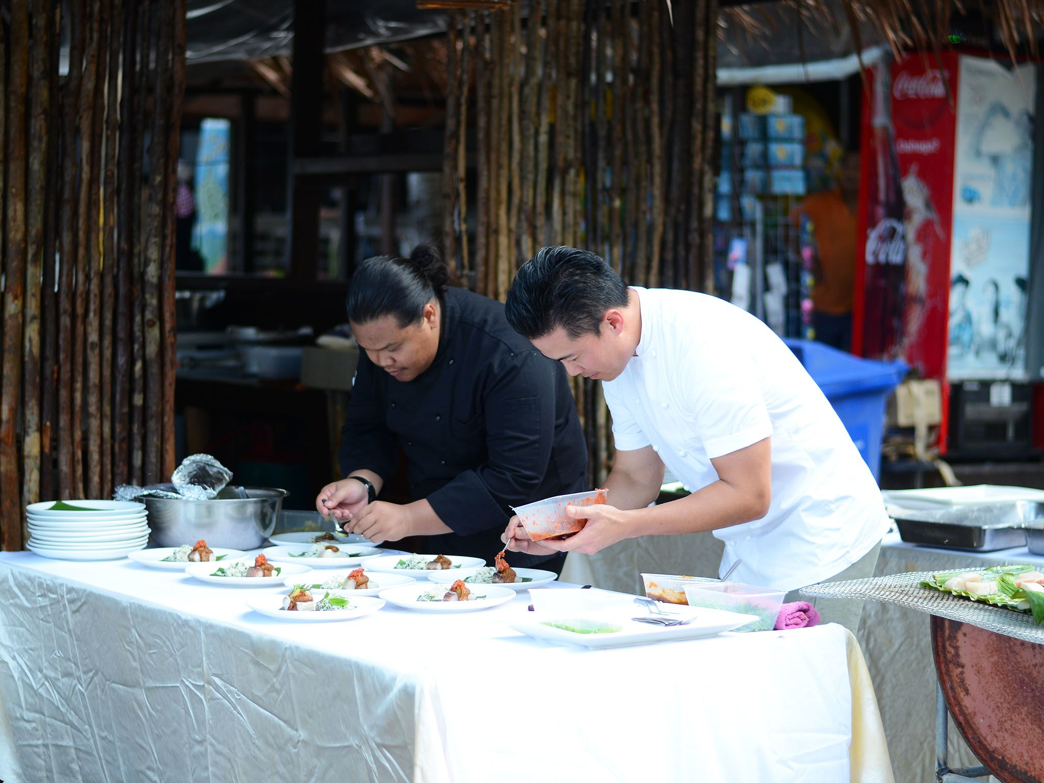 Terengganu, Malaysia: It's time to plate. Viet and Taufiq plates the dish uniformly yet... [Photo of the day - نوامبر 2016]
