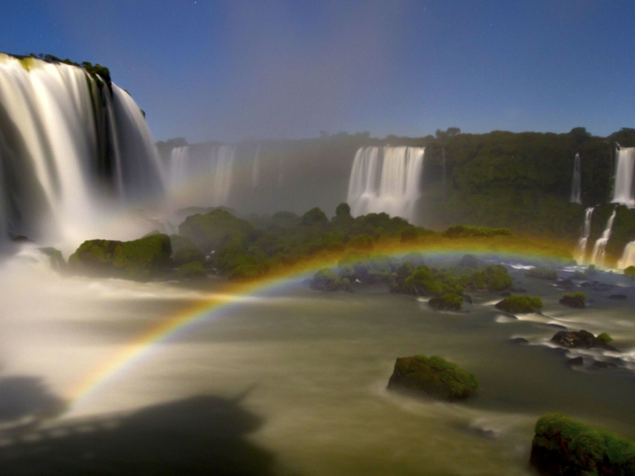 Iguazu Falls with rainbow in the mist. This image is from River in the Sky. [Photo of the day - December 2016]