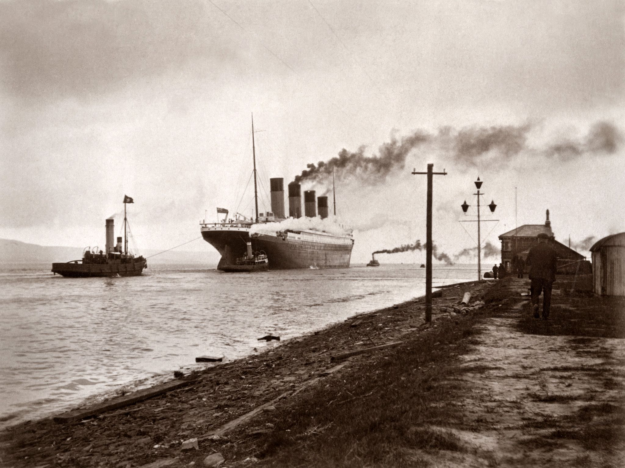 Titanic being pulled out to sea in Belfast.  This image is from Titanic's Fatal Fire. [Photo of the day - December 2017]
