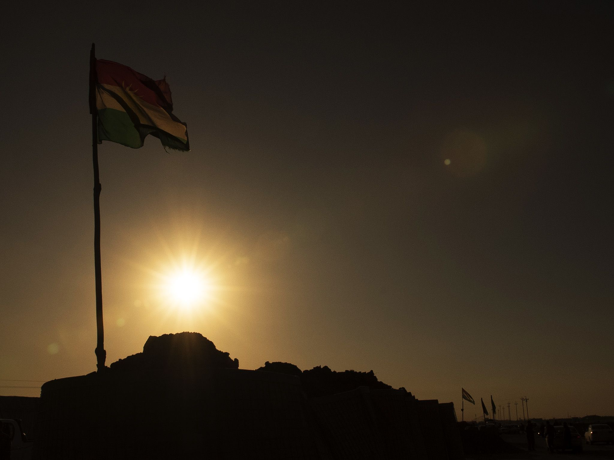 Mosul, Iraq:  A Peshmerga flag in the sun.  This image is from Chain of Command. [Photo of the day - February 2018]