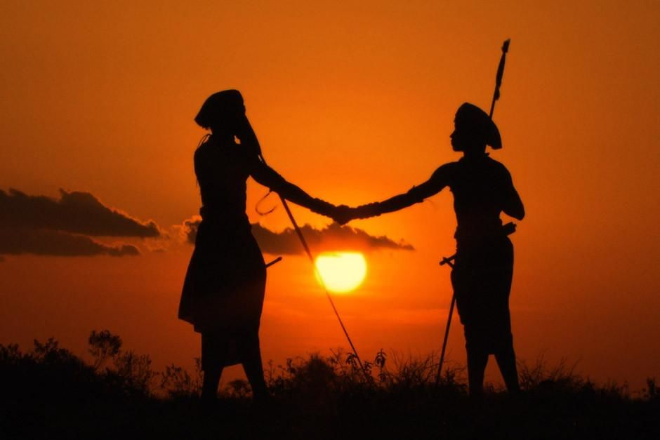 Laikipia, Kenya: Silhouette of Boni and Lemarti shaking hands at sunset. This image is from... [Photo of the day - أبريل 2012]