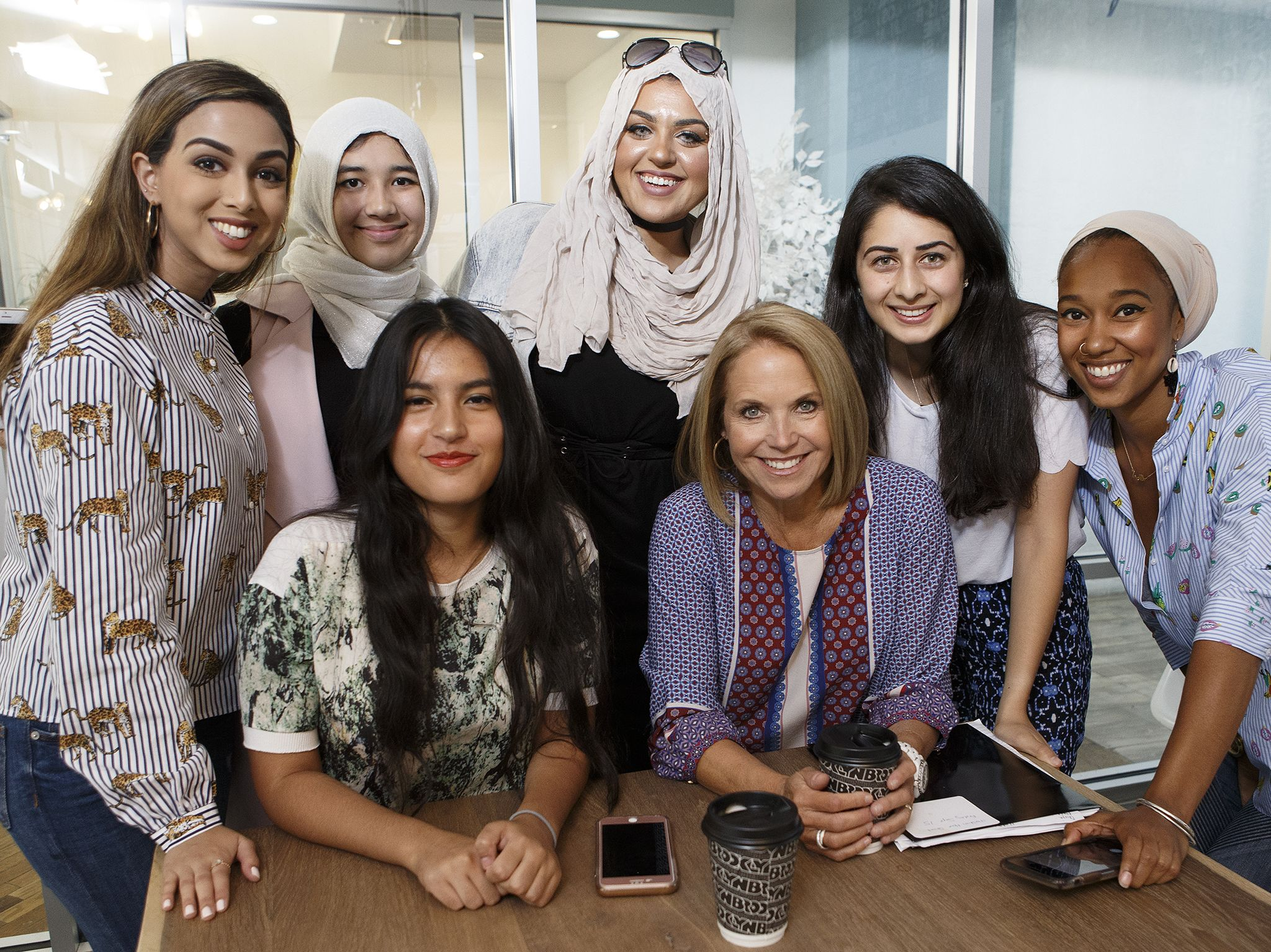New York, NY:  Katie Couric (seated right) at the MuslimGirl office with Amani Al-Khatahtbeh... [Photo of the day - August 2018]