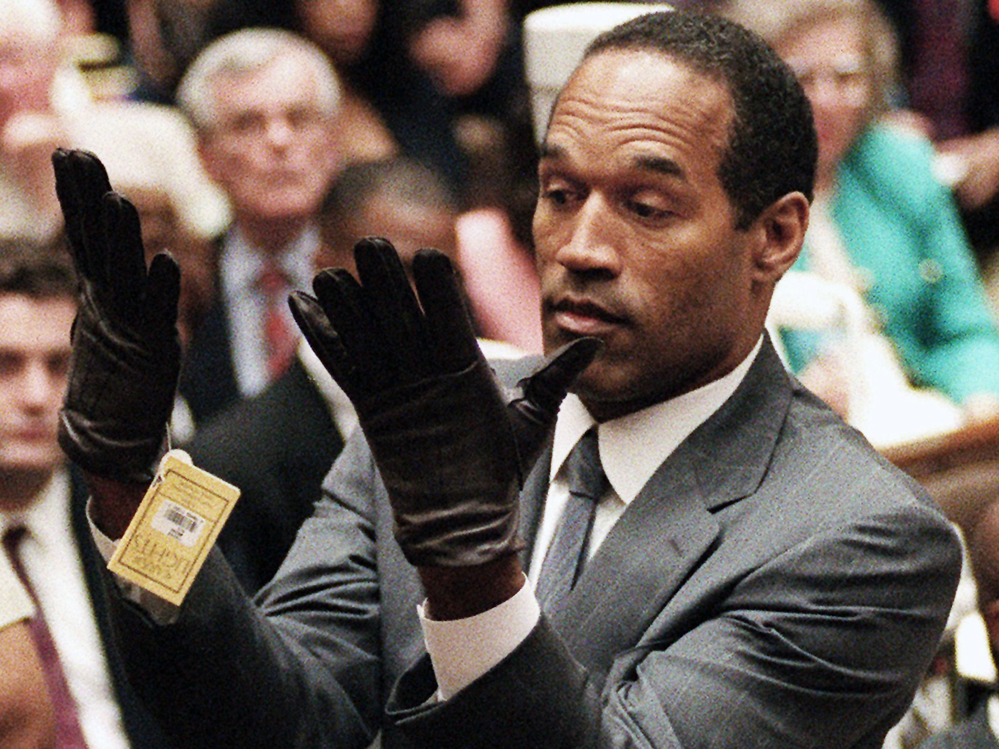 O.J. Simpson holds up his hands before the jury after putting on a new pair of gloves similar to... [Photo of the day - October 2018]