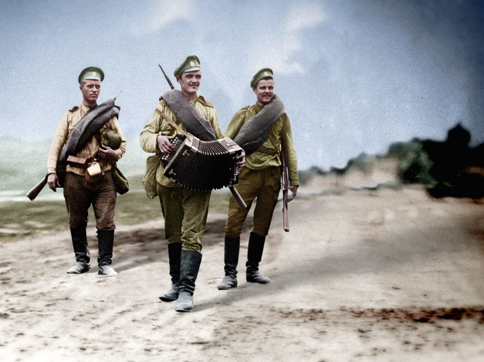 Soldiers follow as another plays accordion.  This image is from 1917: One Year, Two Revolutions. [Photo of the day - February 2019]