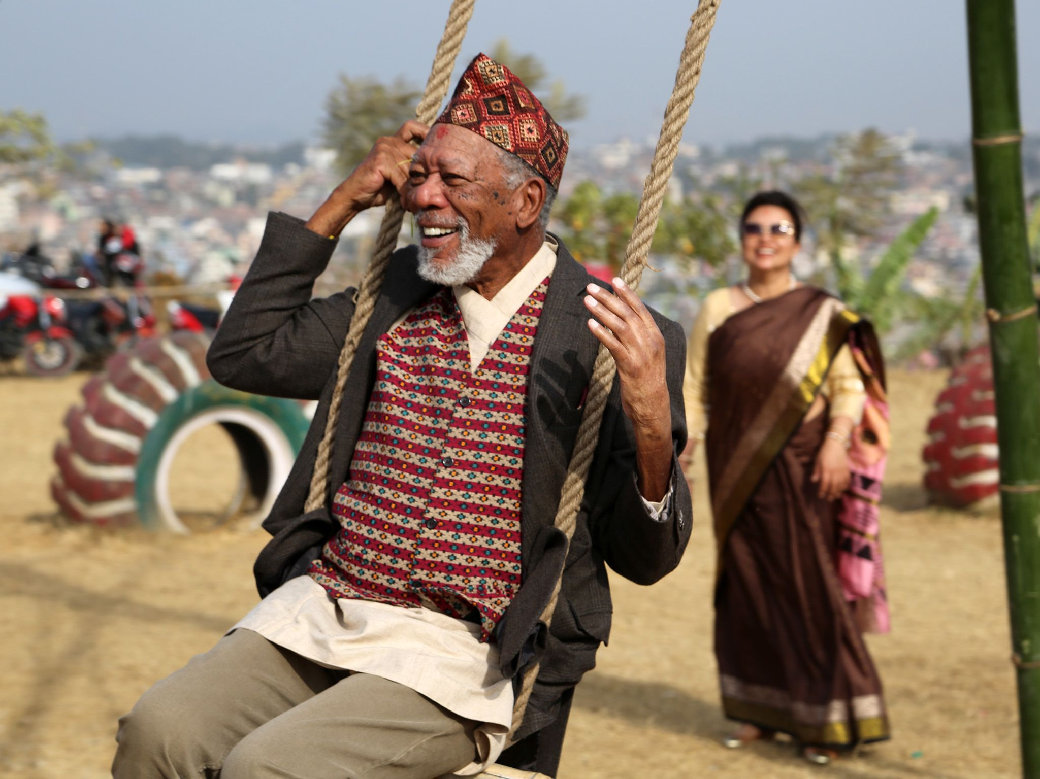 Morgan Freeman swings atop of a mountain in Kathmandu, Nepal.  This image is from The Story of... [Photo of the day - March 2019]