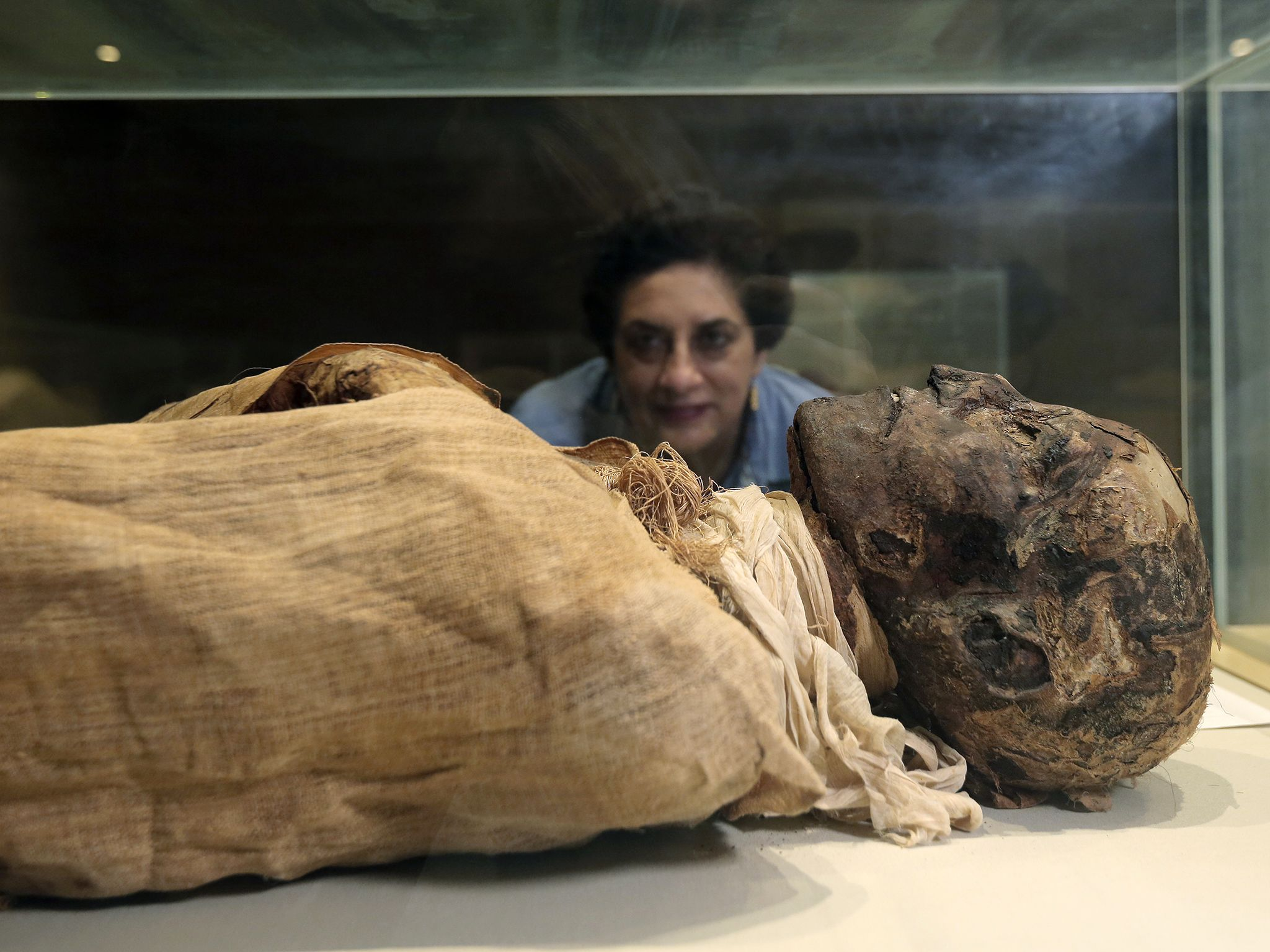Cairo Museum, Egypt:  Salima Ikram looking at the mummy of Rameses III.  This image is from Lost... [Photo of the day - March 2019]
