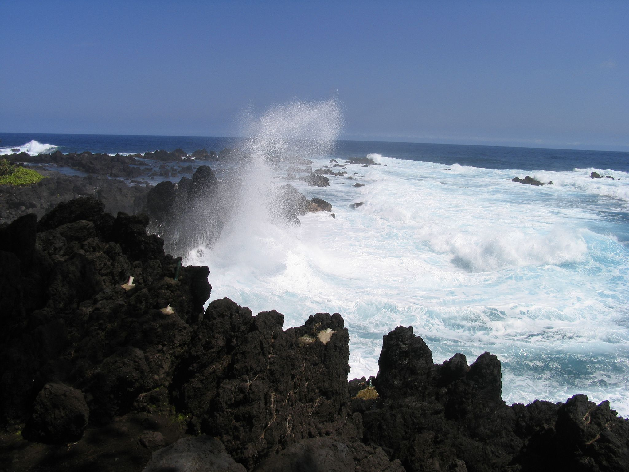 Black lava rock jutting out of the ocean at picturesque Laupahoehoe Park. This image is from... [Photo of the day - April 2019]