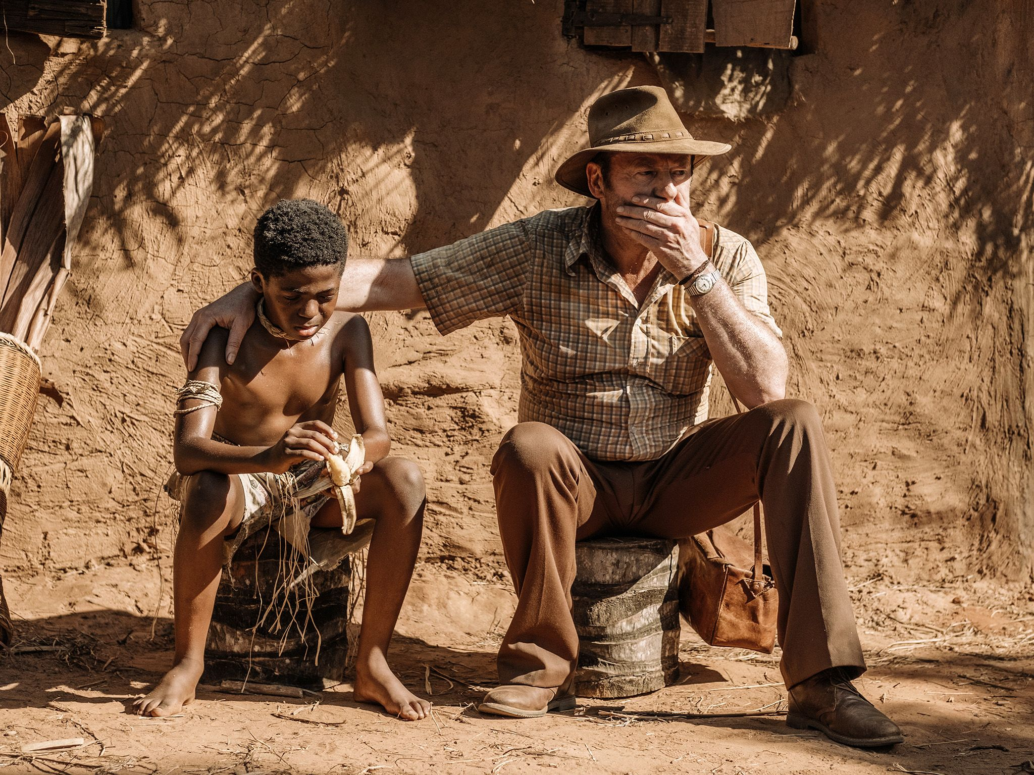Wade Carter (Liam Cunningham),  sits with a young boy in Zaire.  This image is from The Hot Zone. [Photo of the day - May 2019]