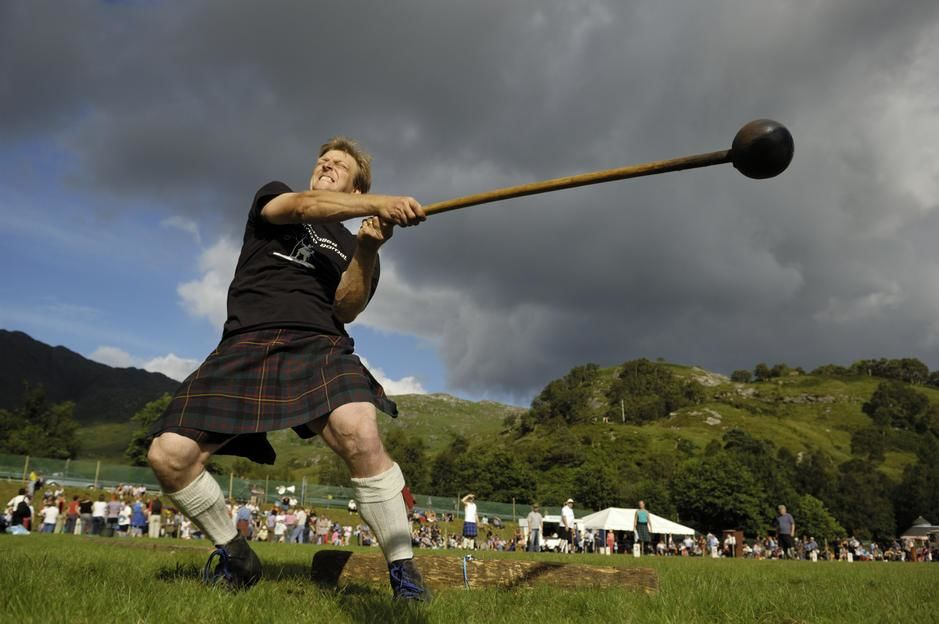 A kilted man throws a pole at the Glenfinnan Highland Games in Scotland. UK. [Photo of the day - September 2011]
