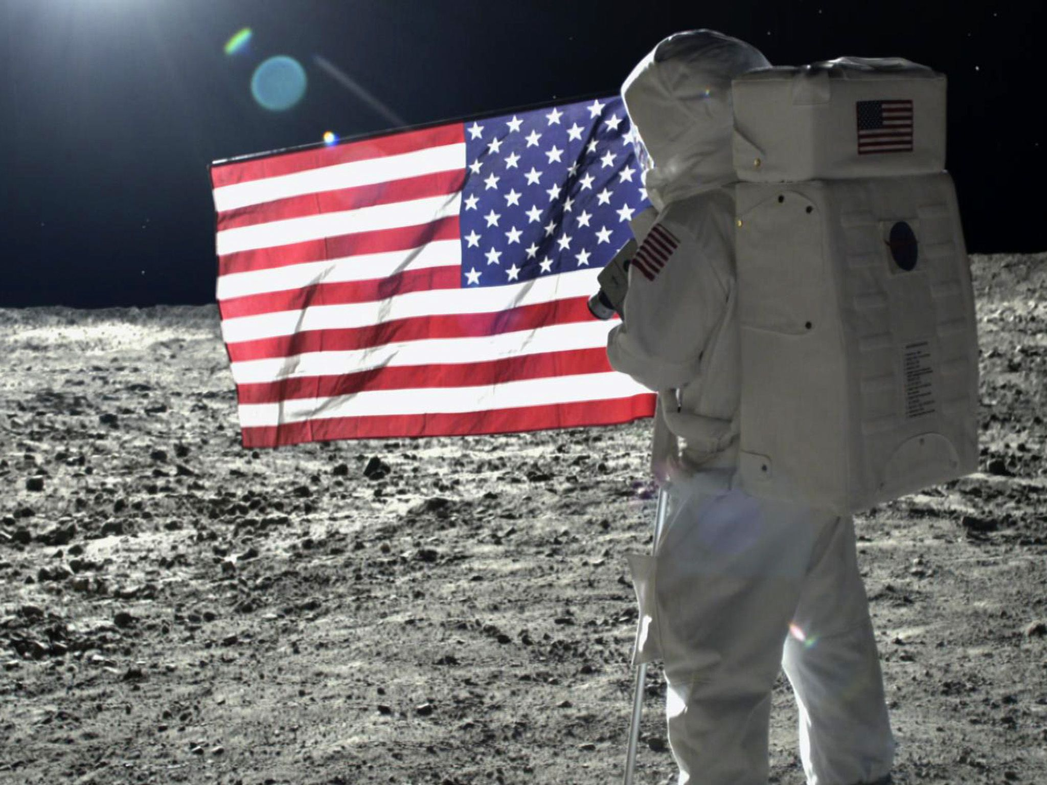 Astronaut Neil Armstrong on the moon unfolding the US flag.  This image is from Apollo: Back to... [Photo of the day - ژولیه 2019]