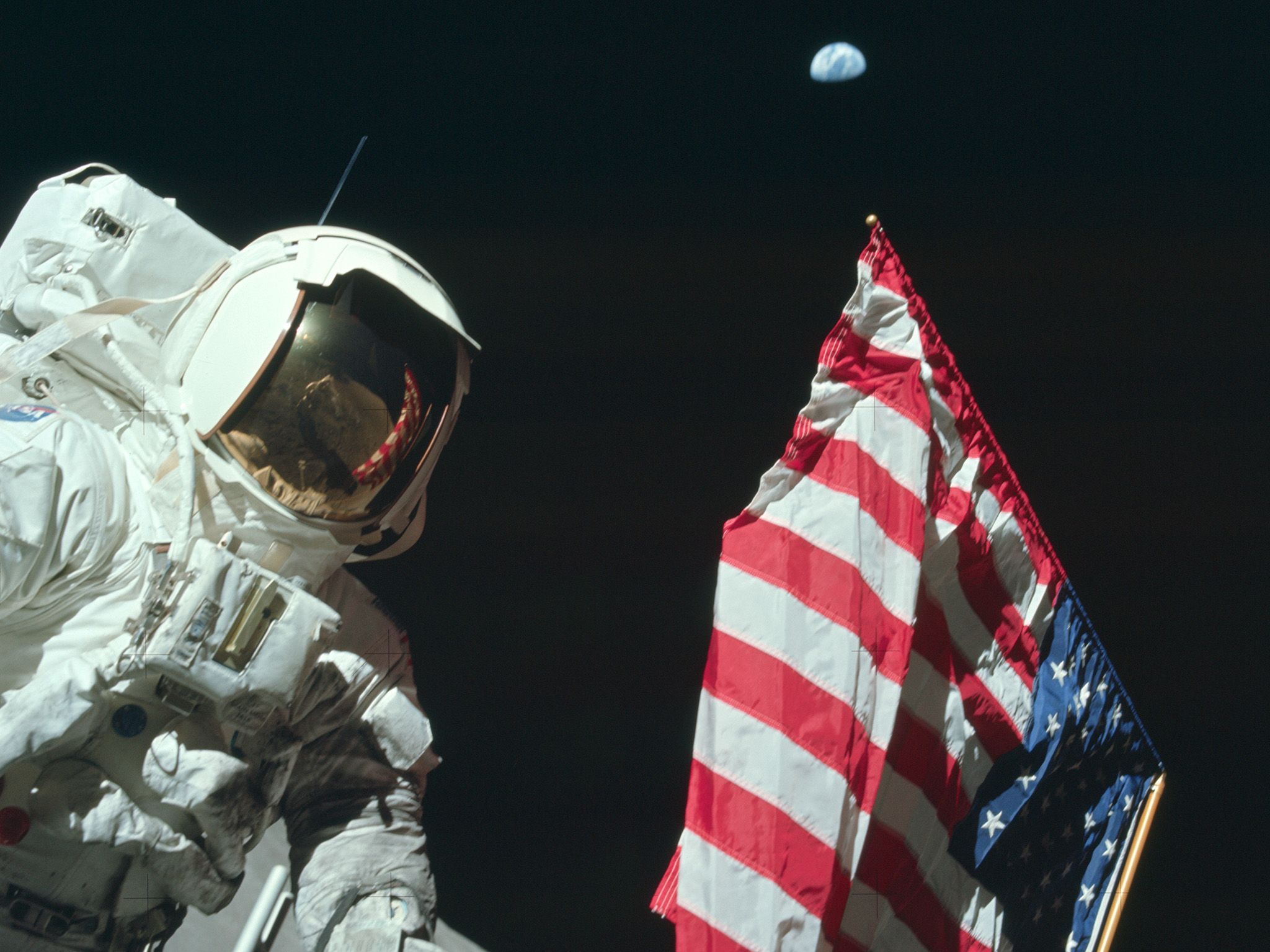 Eugene Cernan planting flag on Moon during Apollo 17.  This image is from Apollo: Missions to... [Photo of the day - ژولیه 2019]