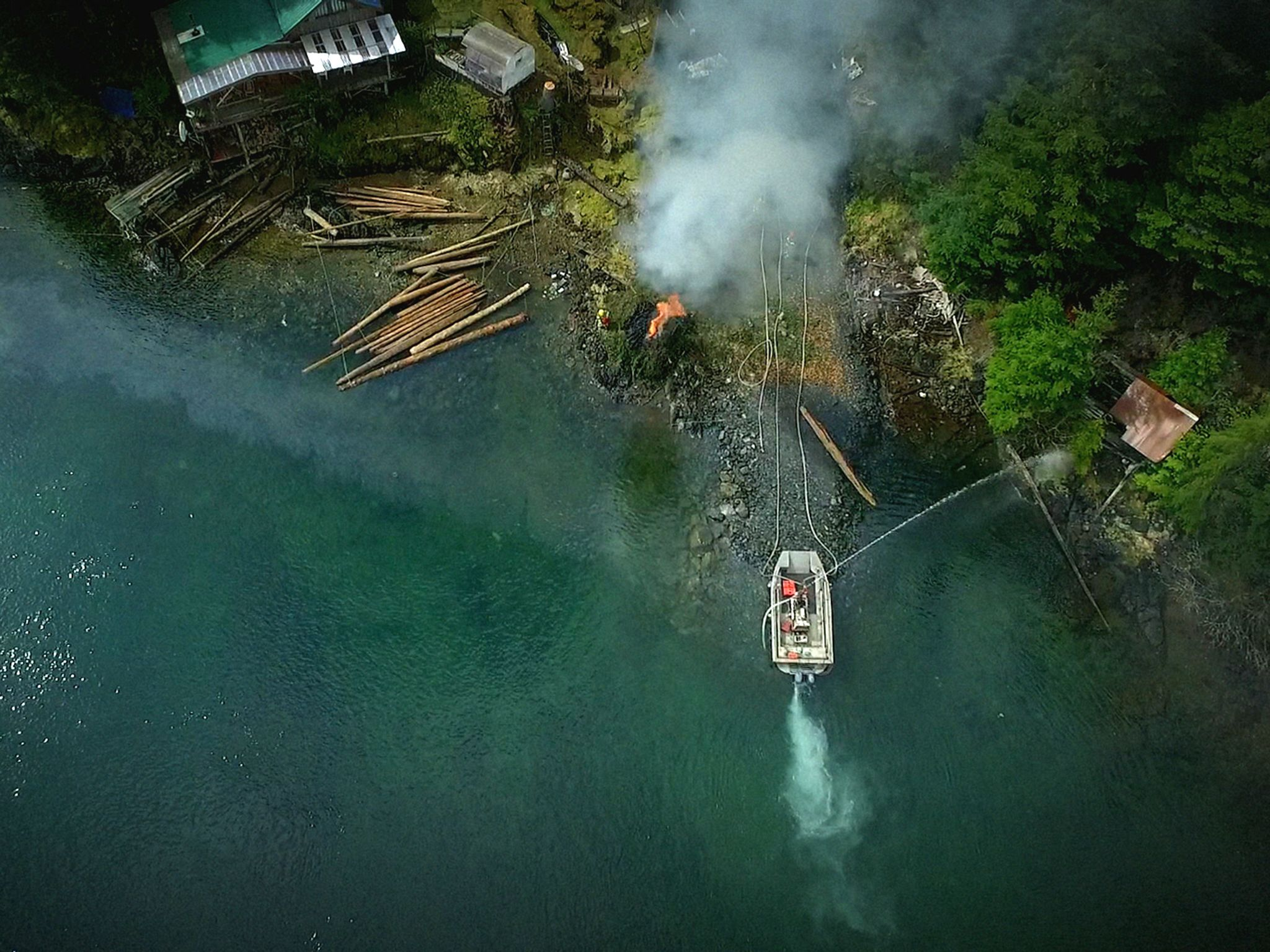 Port Protection, Alaska:  Sam and other local firefighter volunteers put out a small fire in... [Photo of the day - August 2019]