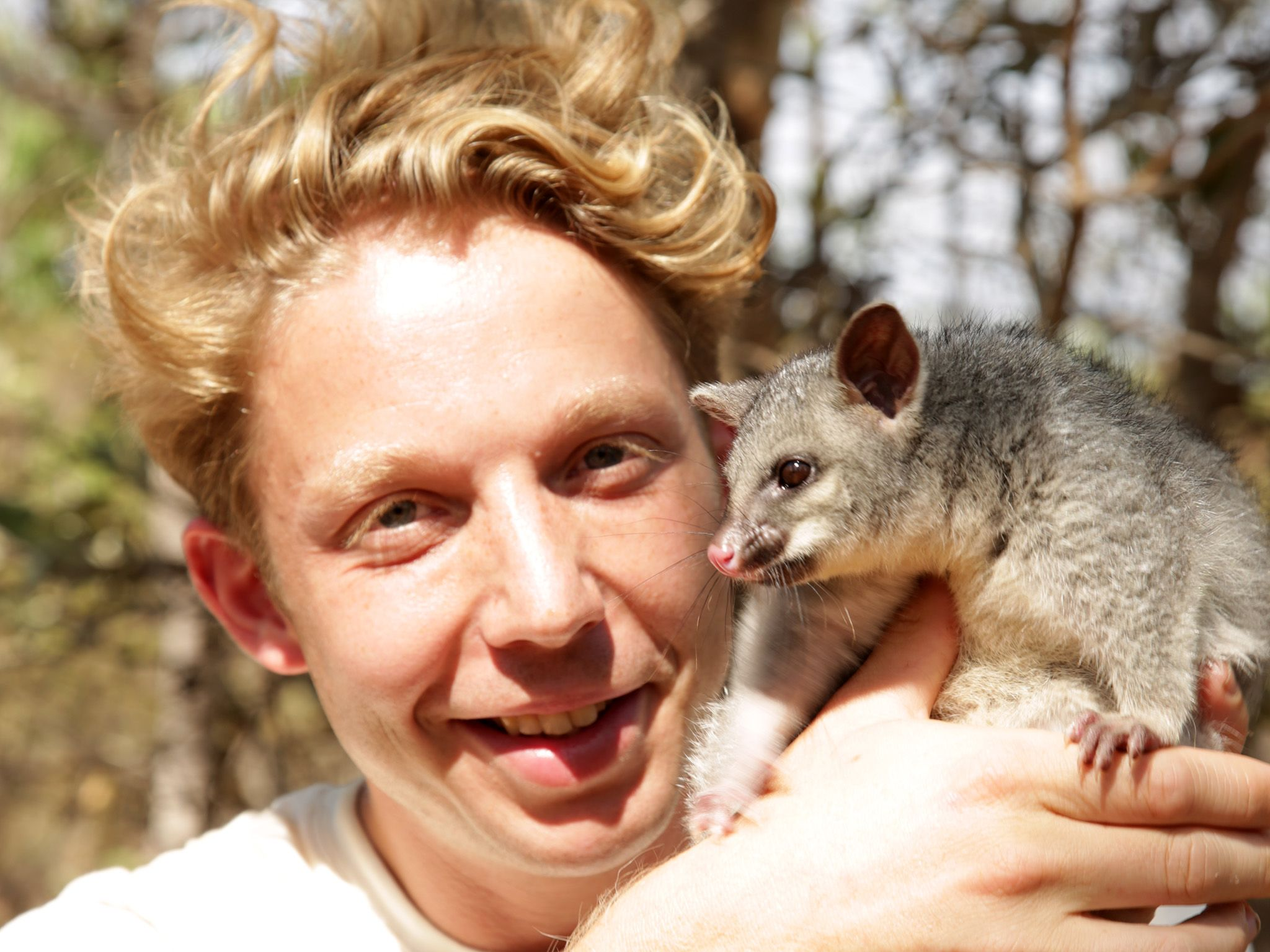 Litchfield National Park, Northern Territory Australia:  Jack Randall holds a brushtail possum... [Photo of the day - August 2019]