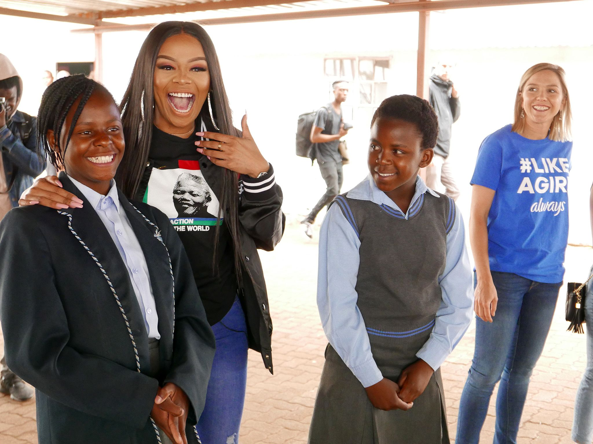 Bonang Matheba jokes with students at Thabotona Primary Farm School. This image is from... [Photo of the day - سپتامبر 2019]