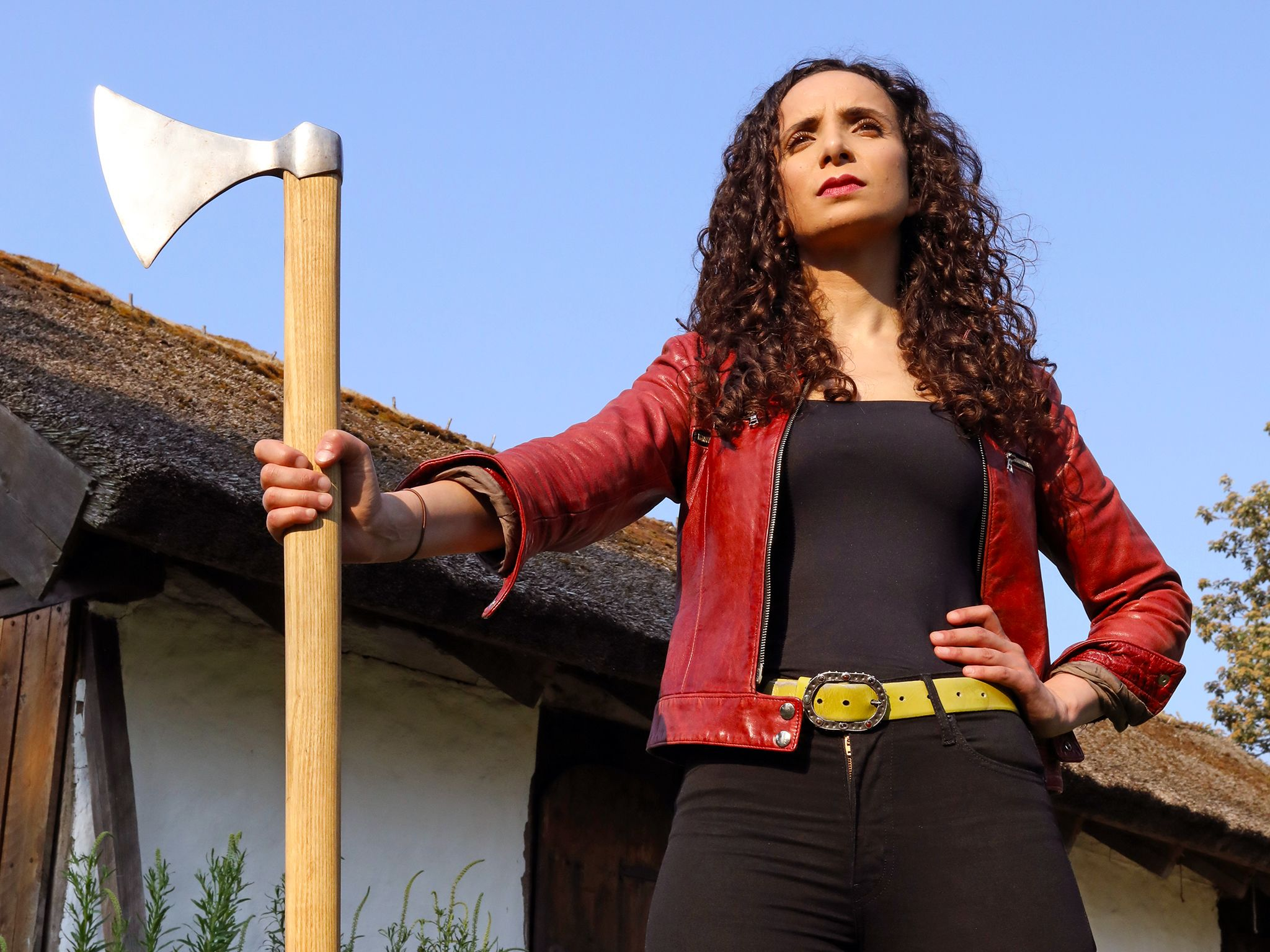 Ella at Trelleborg Fortress, Denmark holding Viking axe. This image is from Viking Warrior Queens. [Photo of the day - October 2019]