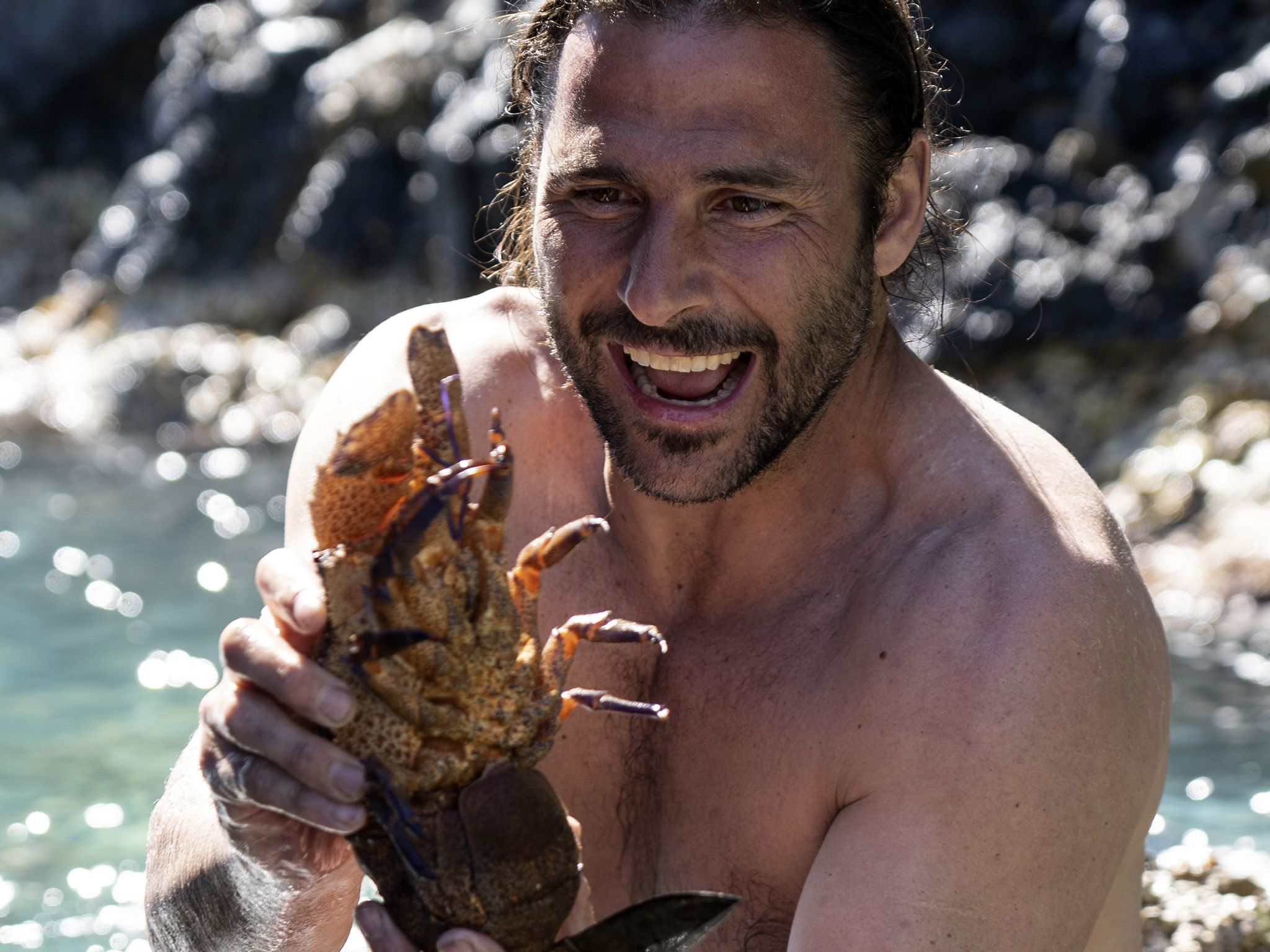 Hazen Audel holds a lobster he caught by hand in the sea. This image is from Ultimate Survival WWII. [Photo of the day - November 2019]