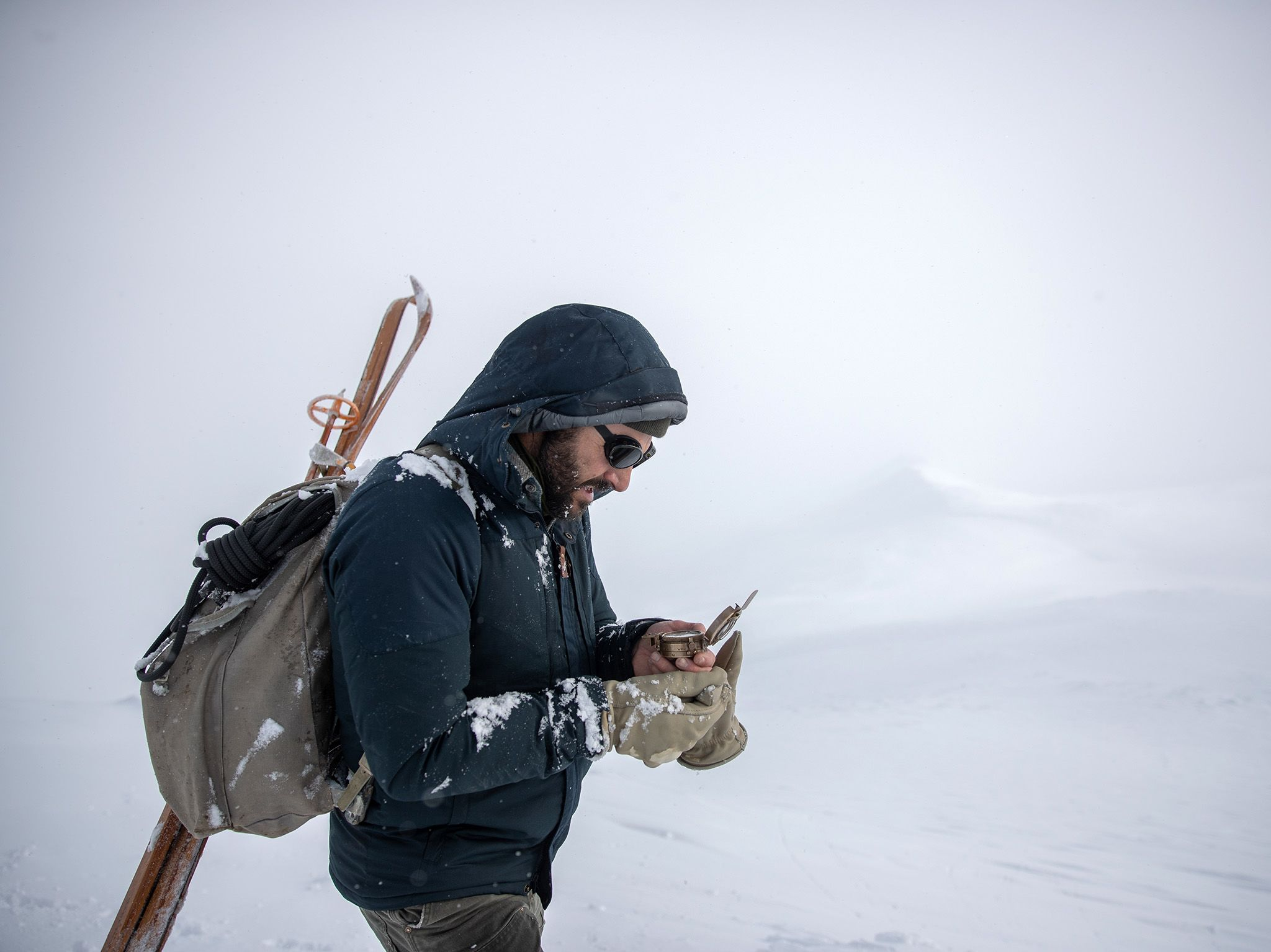 Hazen Audel looks at a compass in the mountains of Norway. This image is from Ultimate Survival... [Photo of the day - نوامبر 2019]