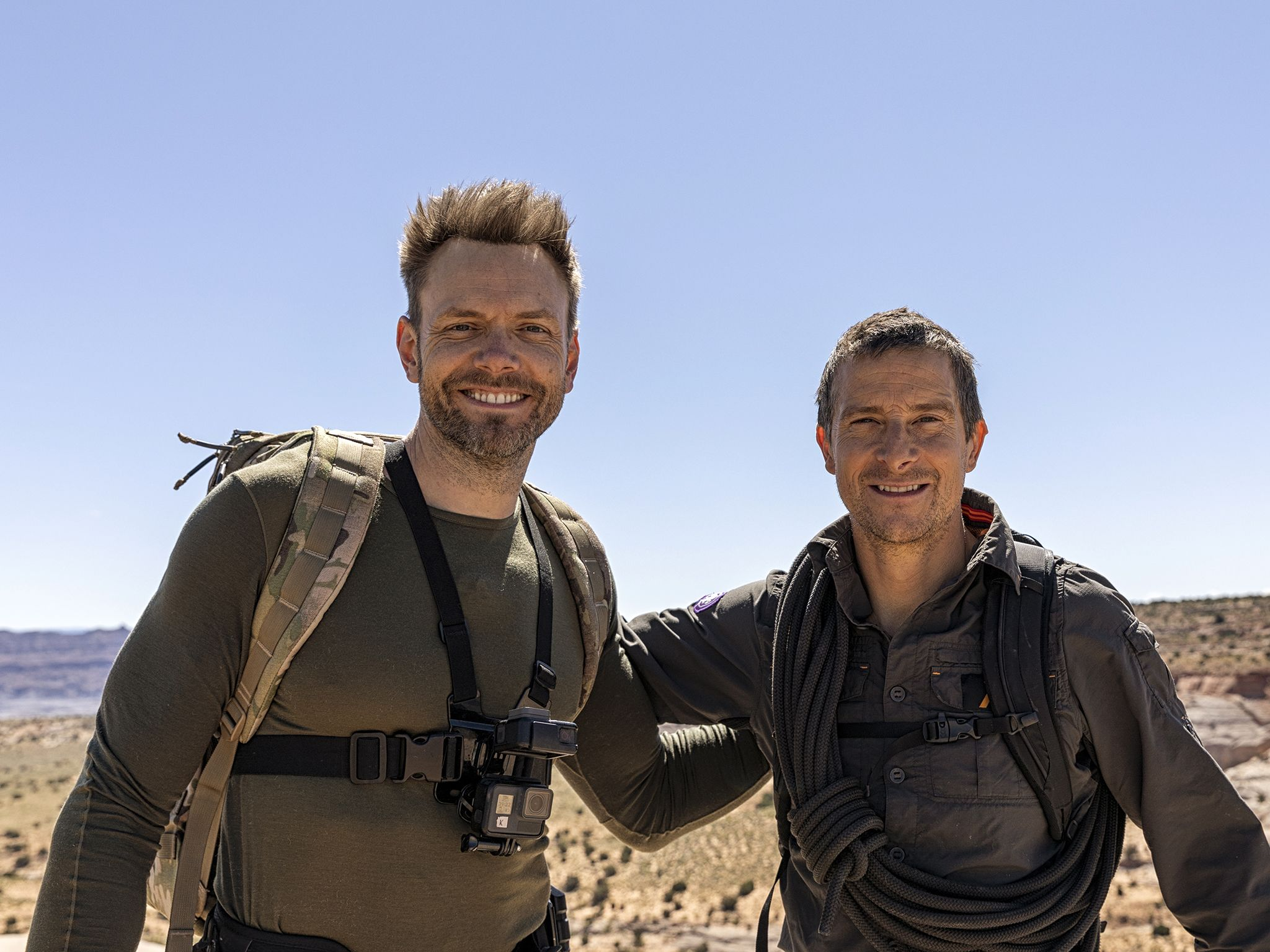 (L to R): Joel McHale and Bear Grylls. This image is from Running Wild with Bear Grylls. [Photo of the day - November 2019]