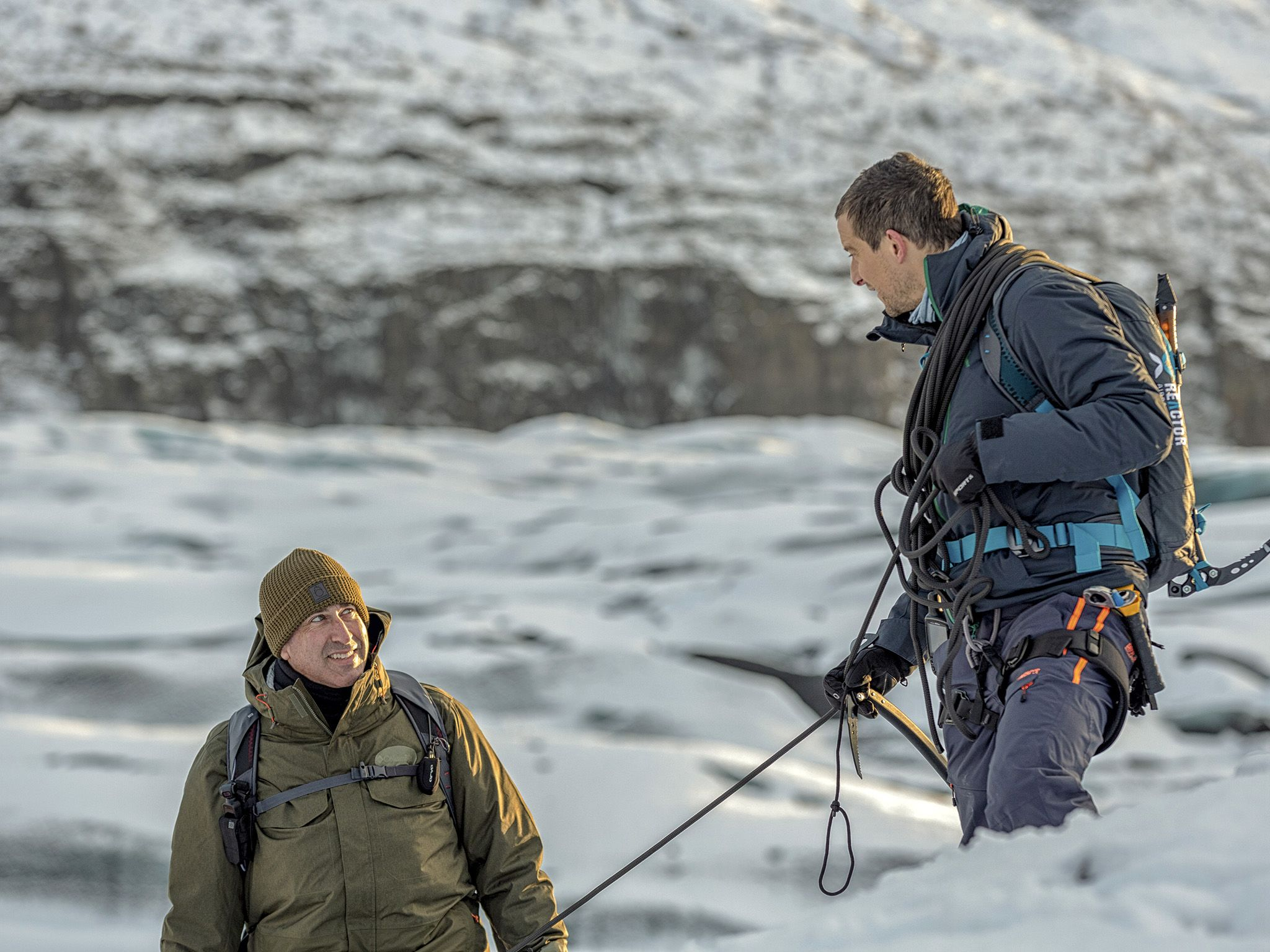 Iceland:  (L to R) Rob Riggle and Host Bear Grylls make their way down from a ridge in Iceland.... [Photo of the day - November 2019]