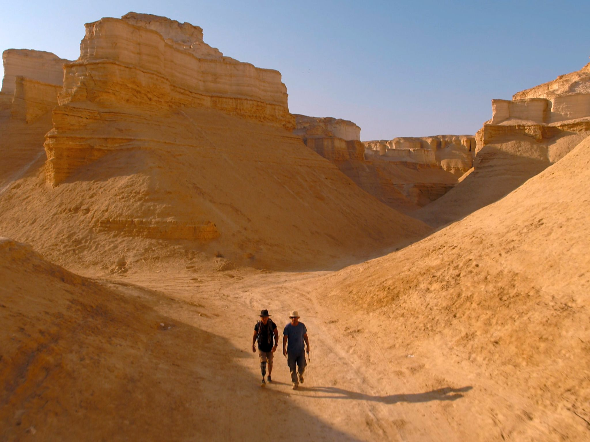 Israel:  Albert Lin and Dr. Adi Torfstein walking through canyon in the Dead Sea Rift valley. ... [Photo of the day - December 2019]